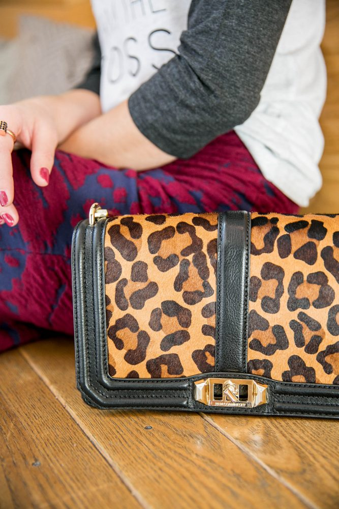 Houston fashion blogger Uptown with Elly Brown wears a Boss Mom T-Shirt with a leopard crossbody