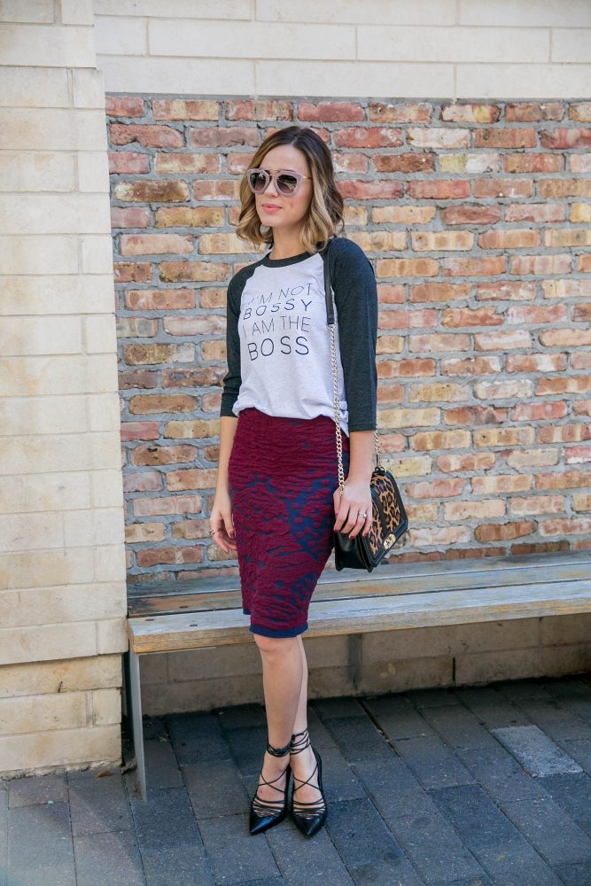 Houston fashion blogger Uptown with Elly Brown wears a Boss Mom T-Shirt with a pencil skirt and high heels.