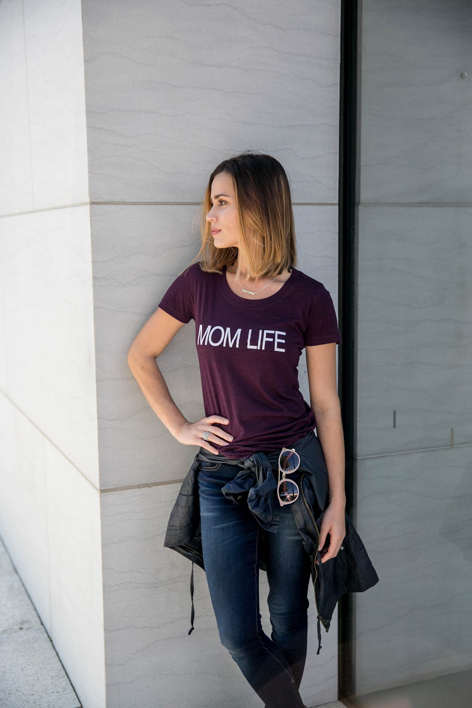 Houston lifestyle blogger Uptown with Elly Brown wears a mom life tshirt