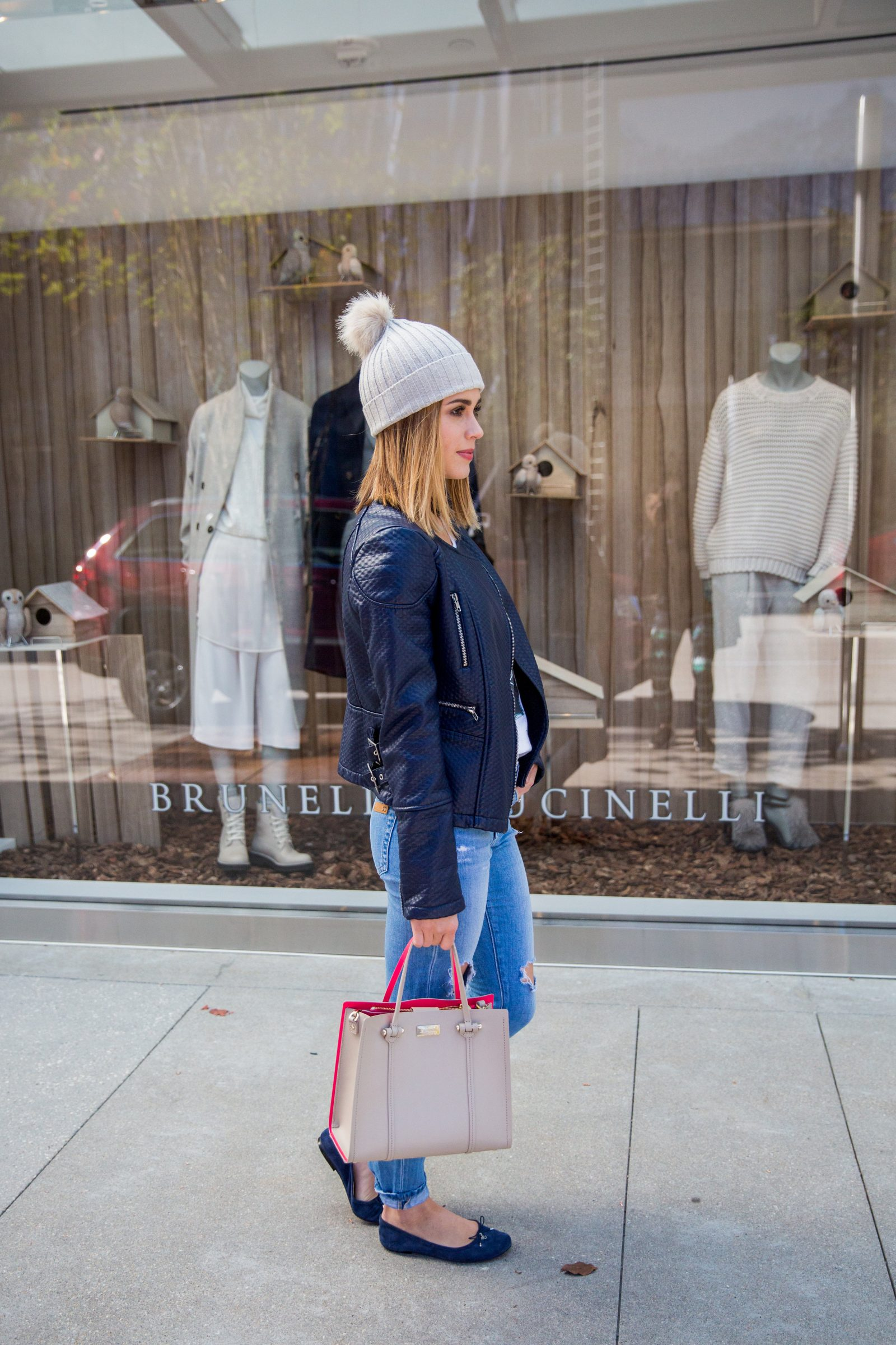 Houston fashion blogger Uptown with Elly Brown wears a blue leather jacket with matching flats