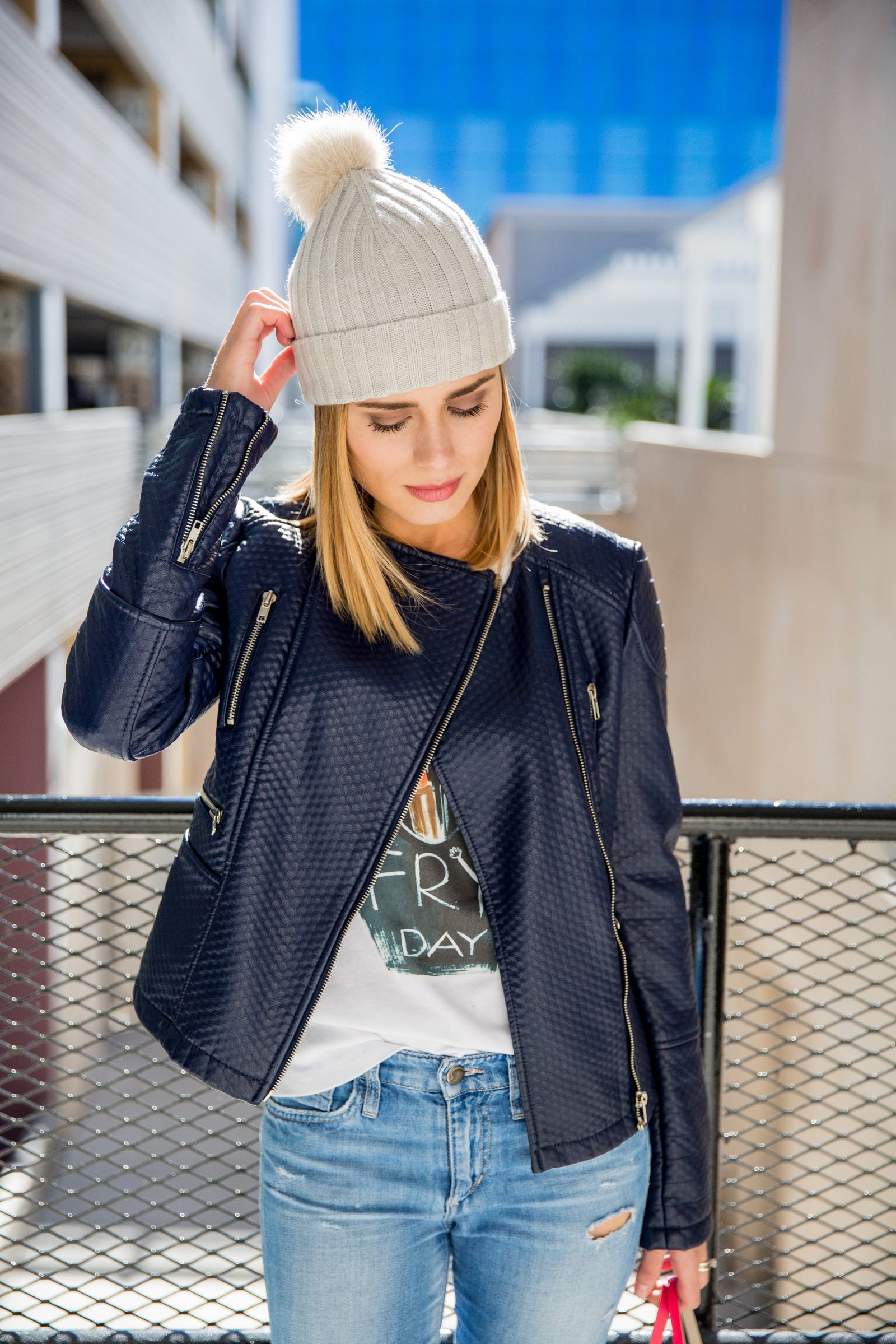 Houston fashion blogger Uptown with Elly Brown wears a blue leather motto jacket