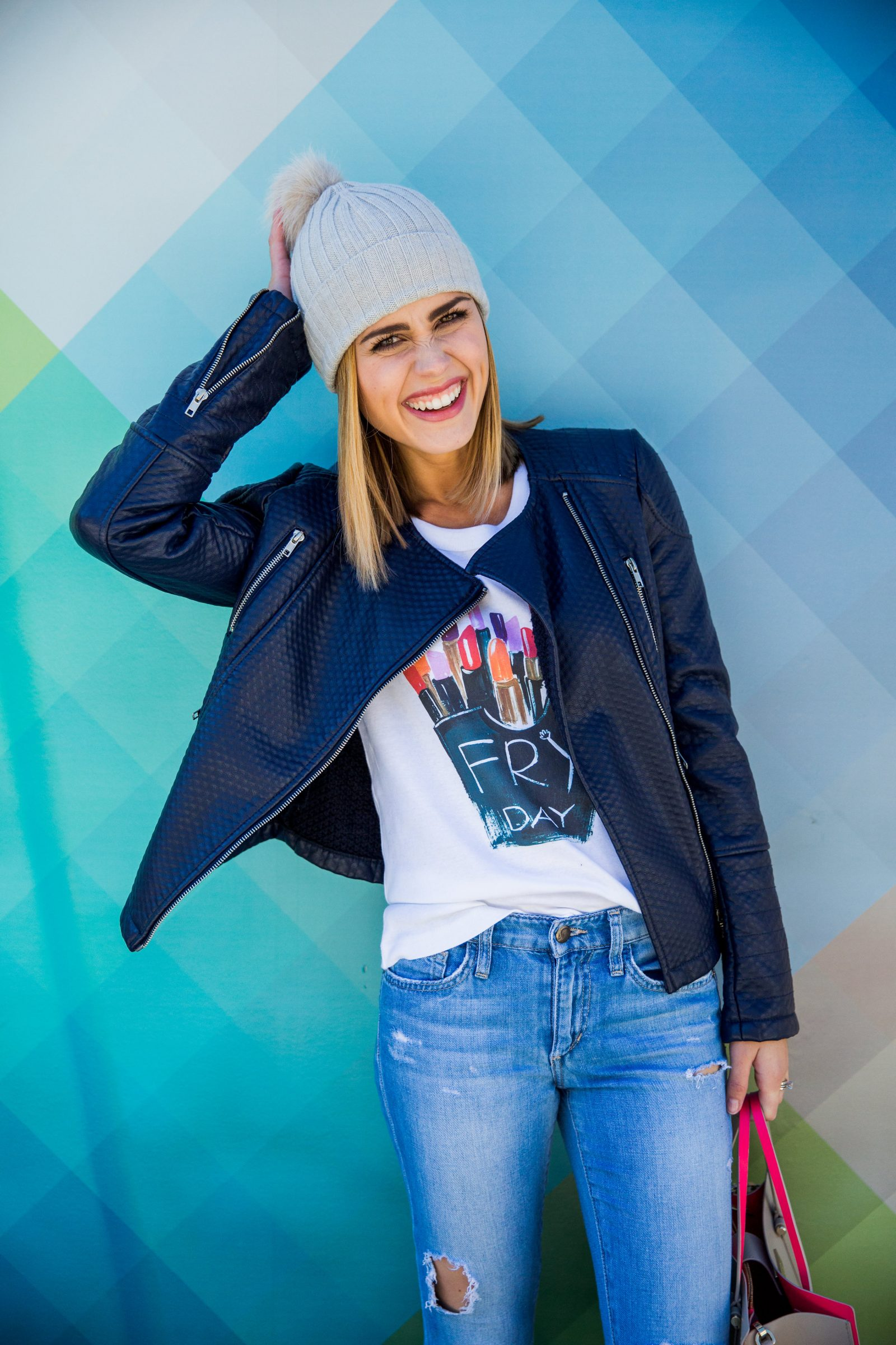 Houston fashion blogger Uptown with Elly Brown wears a faux pompom beanie for the winter
