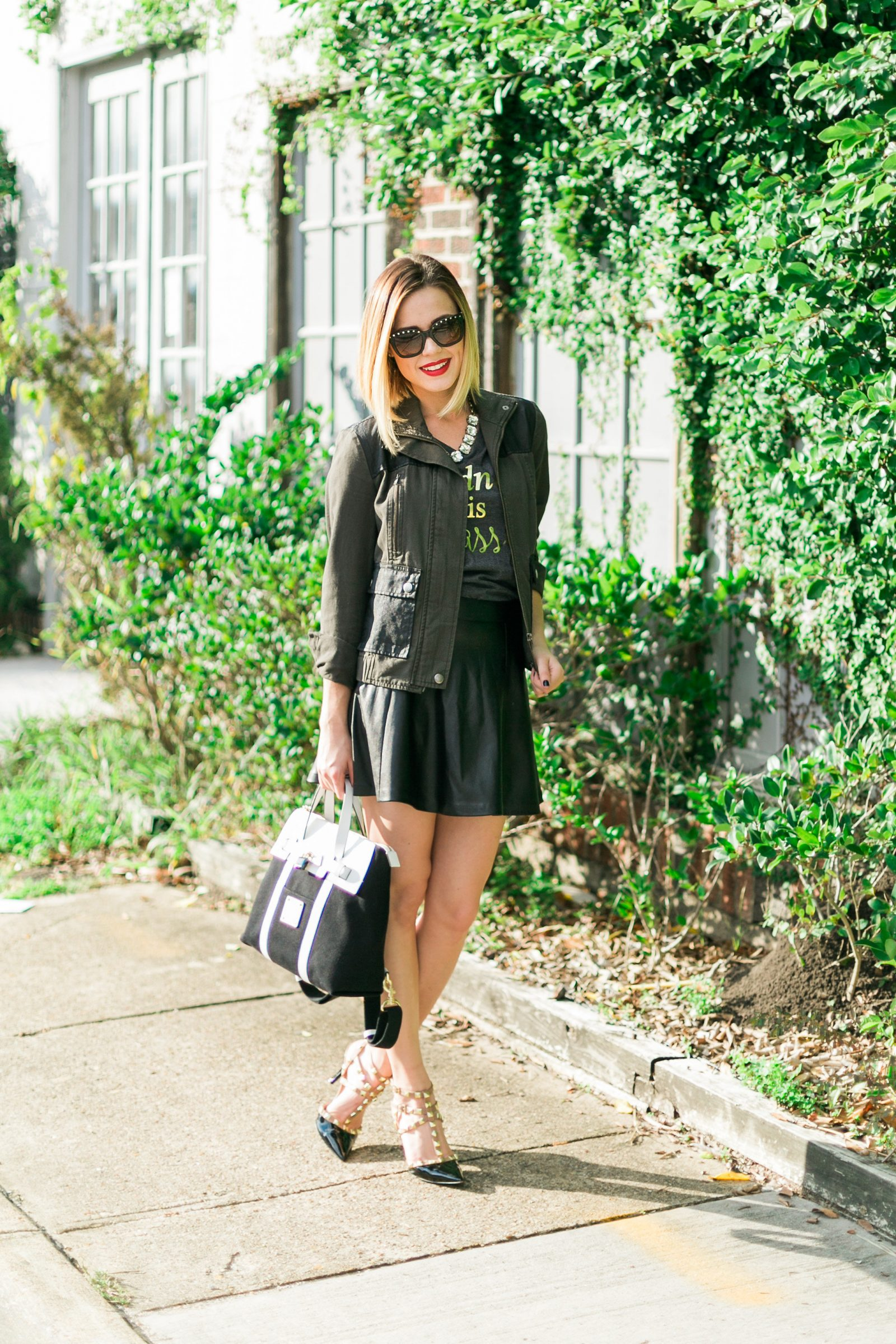 Houston fashion blogger Uptown with Elly Brown wears a faux leather skirt with Valentino stud dupes