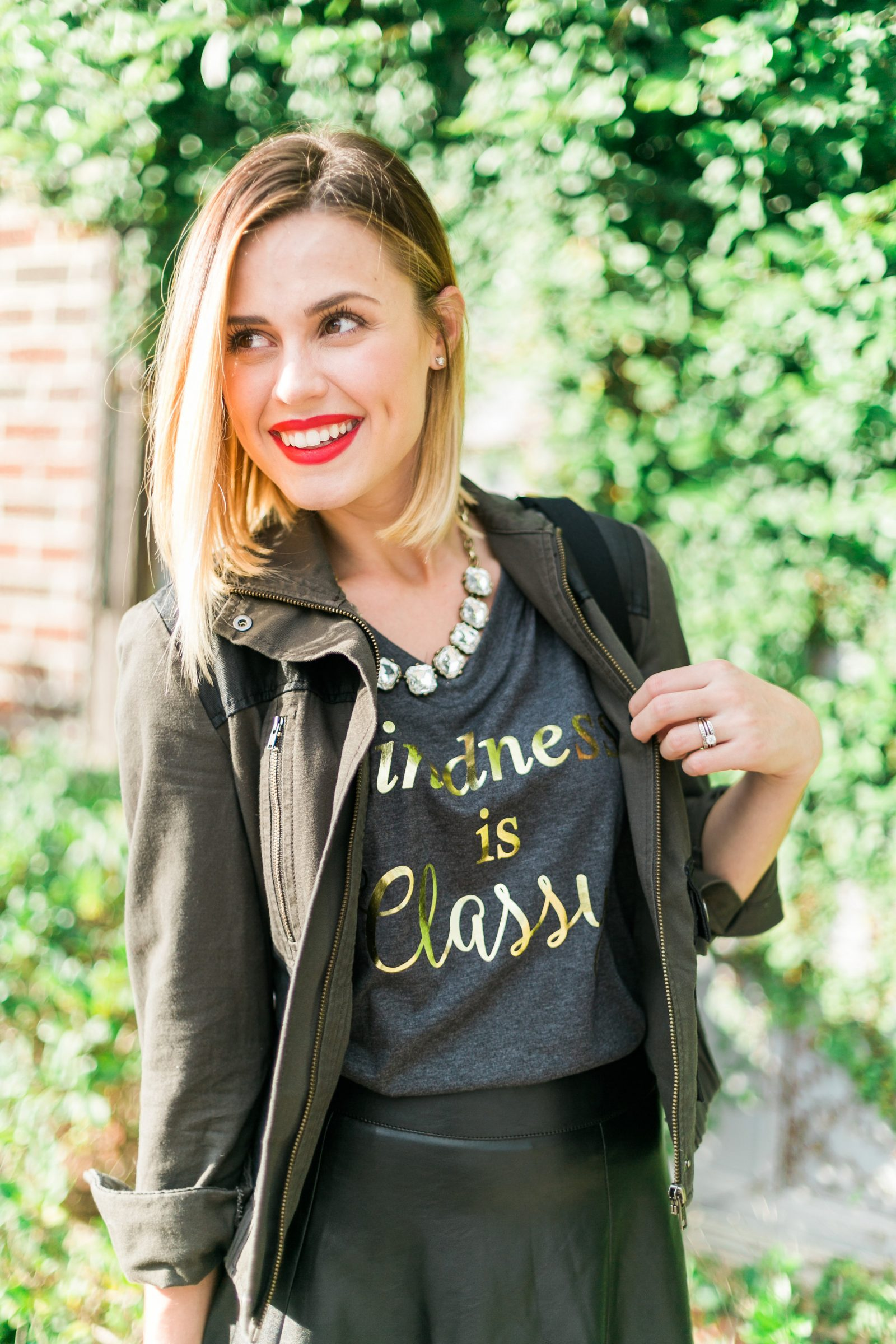 Houston fashion blogger Uptown with Elly Brown wears a kindness is classy tee