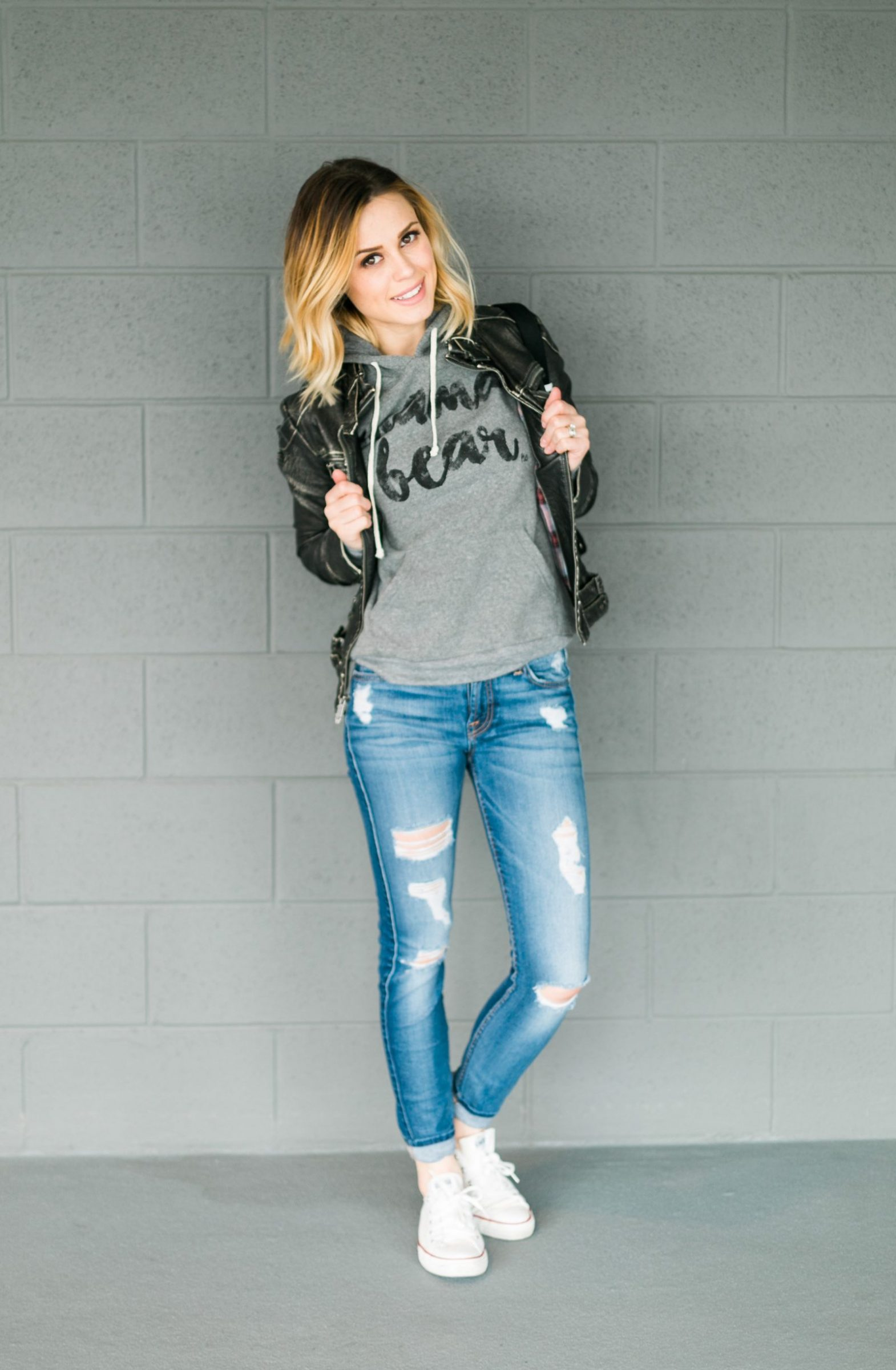 Houston fashion blogger Uptown with Elly Brown wears a casual outfit with chucks