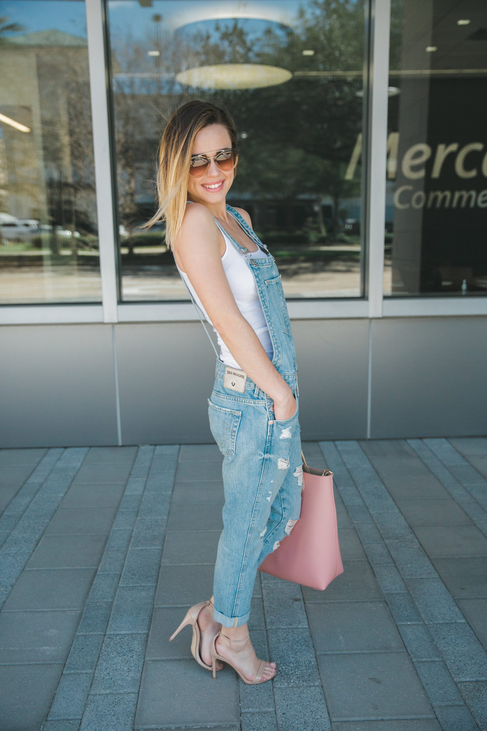 Looking for idead on how to wear Denim Overalls? Houston fashion blogger Uptown with Elly Brown wears and shares how to wear this trend!