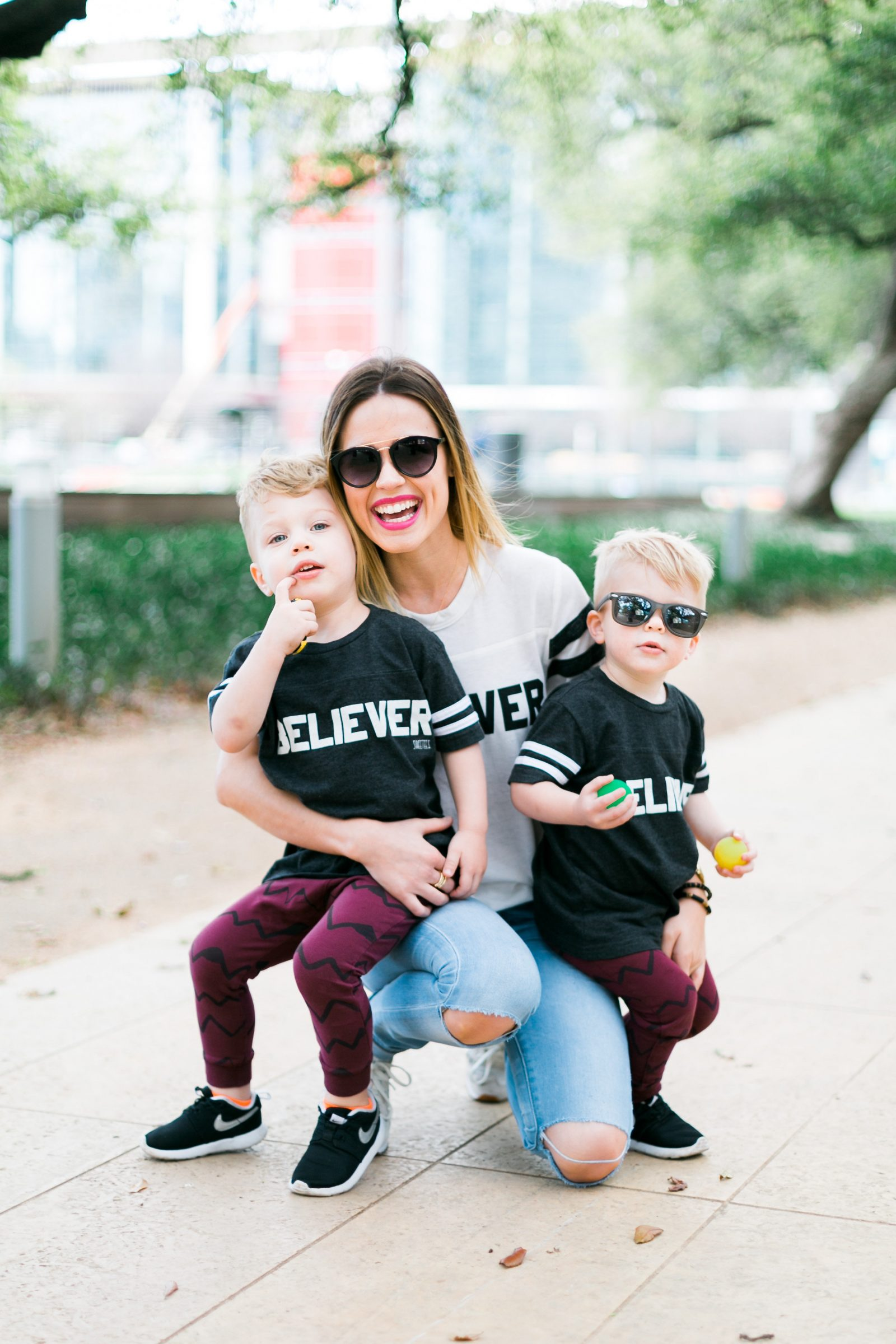 Houston fashion blogger Uptown with Elly Brown wears mommy and me matching tee's with her boys