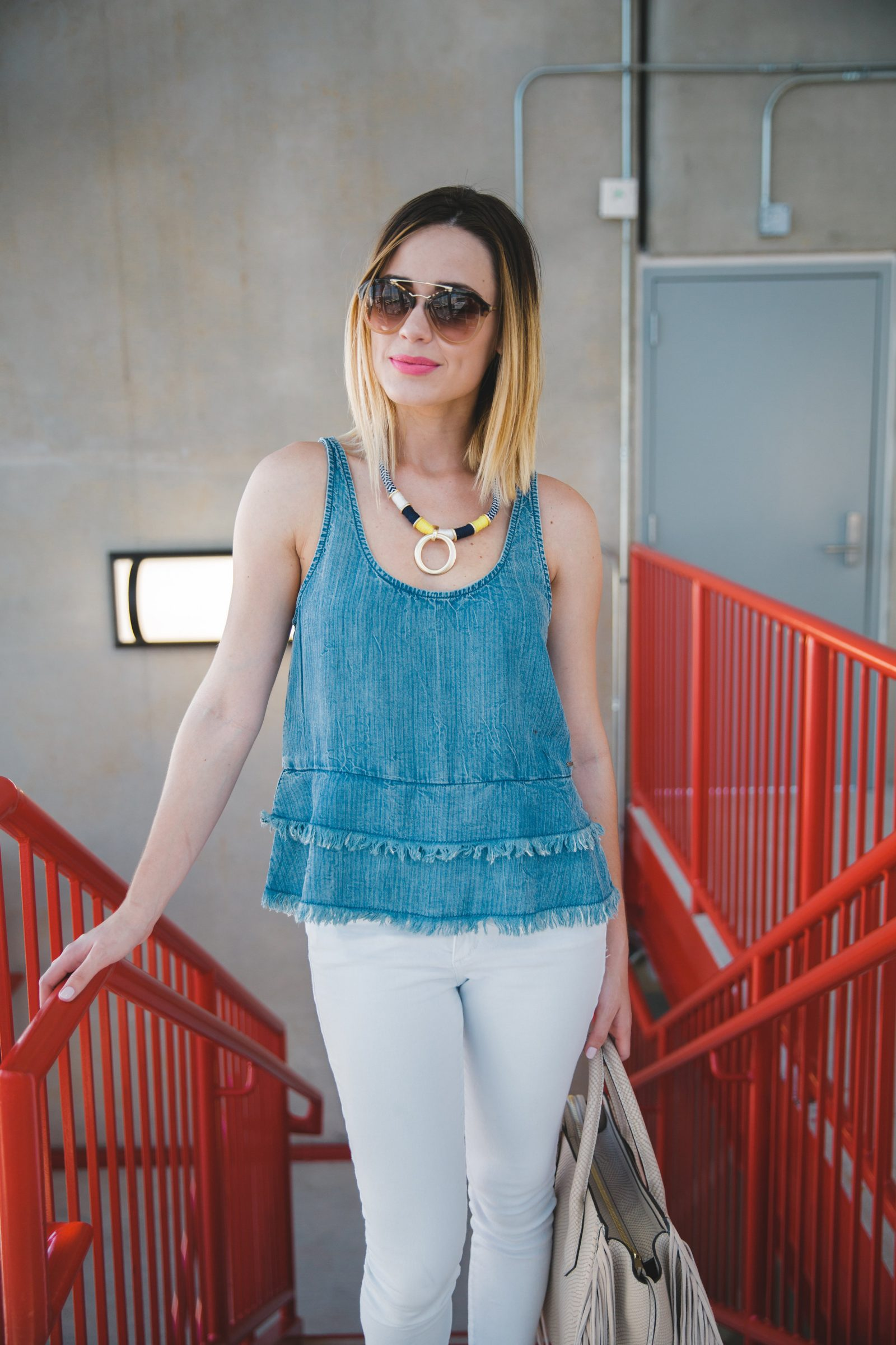 Houston Fashion blogger Uptown with Elly Brown wears a denim on denim outfit for a Casual Spring Look.