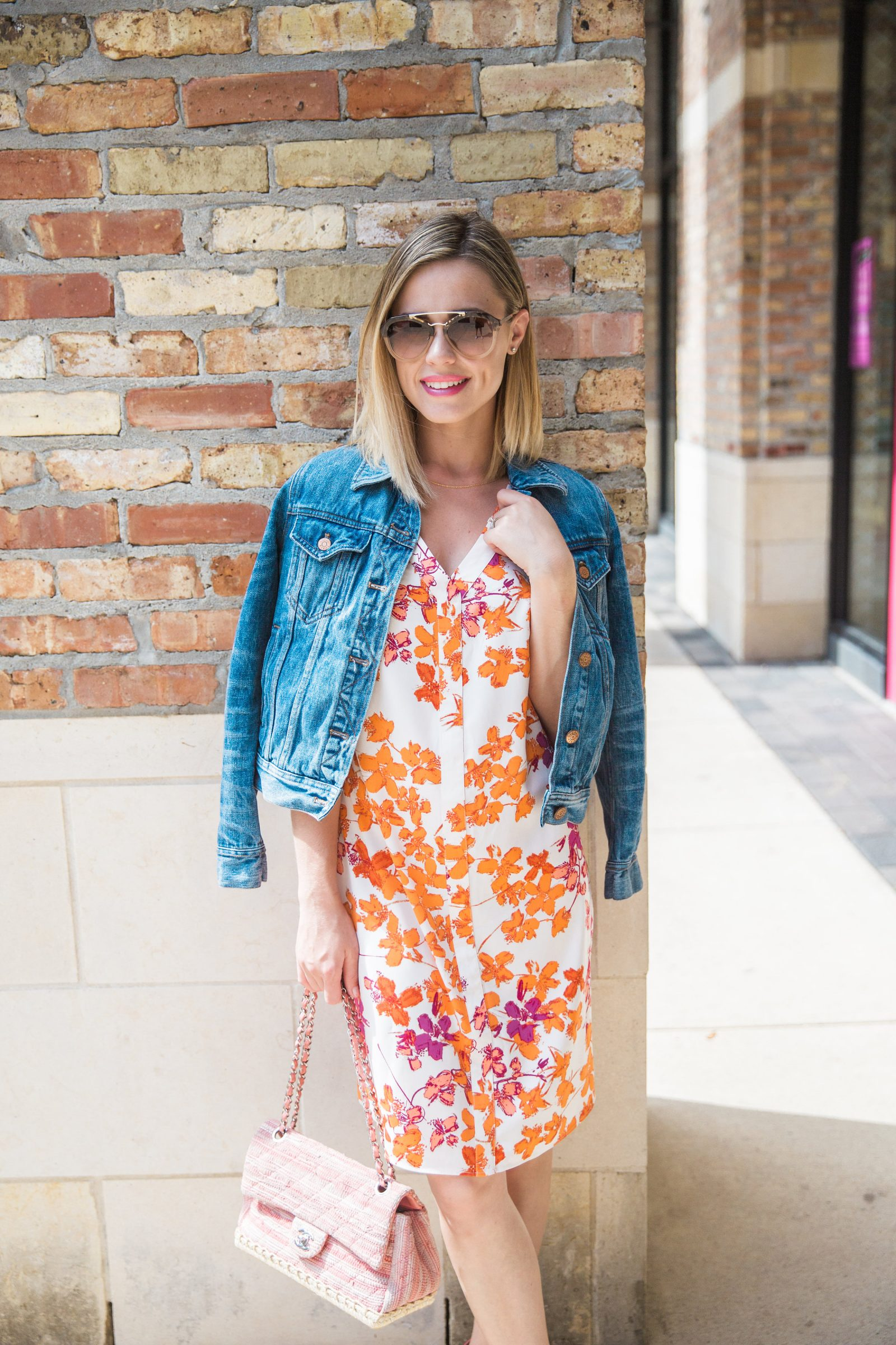 Houston fashion blogger Uptown with Elly Brown wears a fun colorful Floral Dress dropped with a denim jacket for a fresh Spring look!