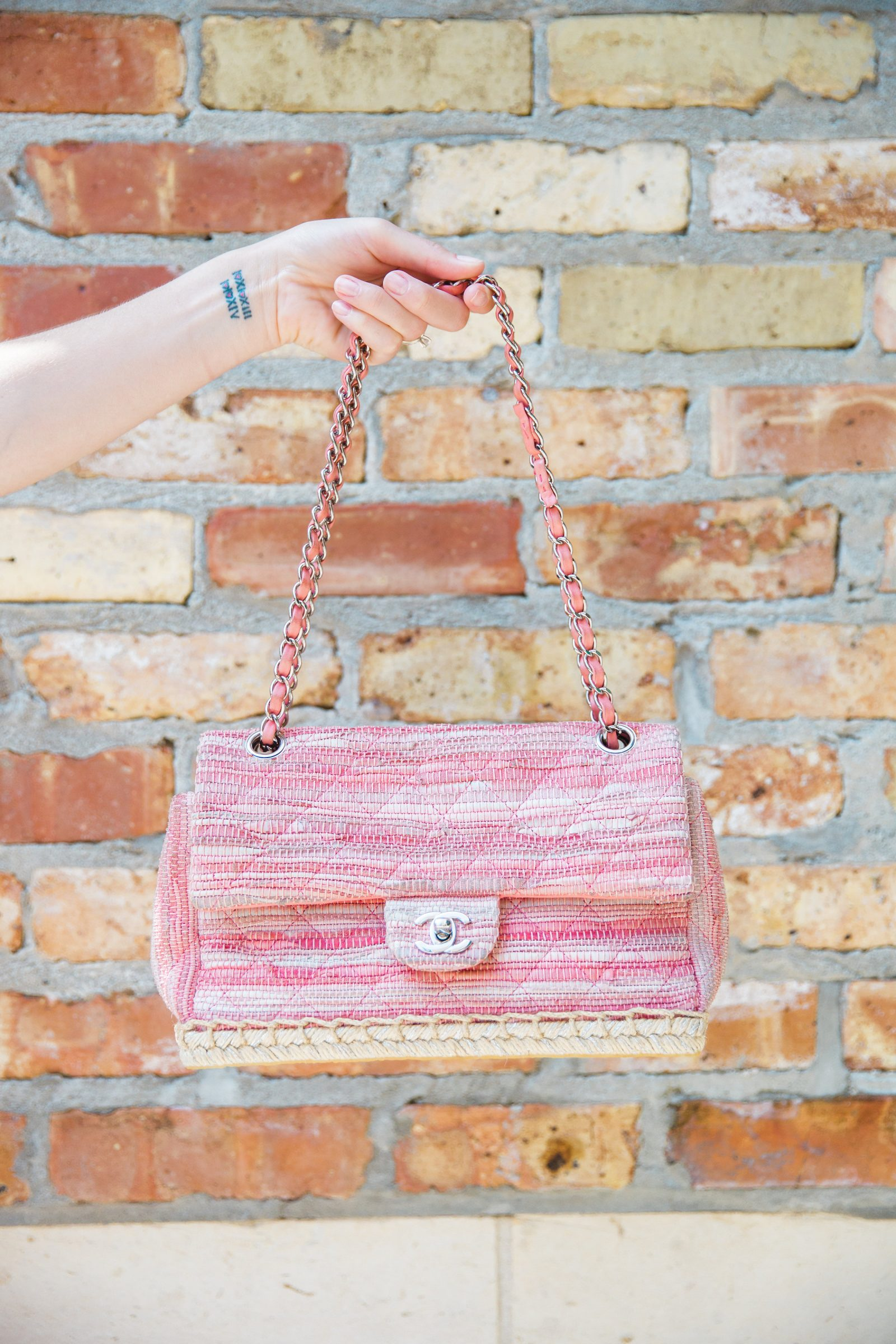 Houston fashion blogger Uptown with Elly Brown wears a vintage Chanel bag