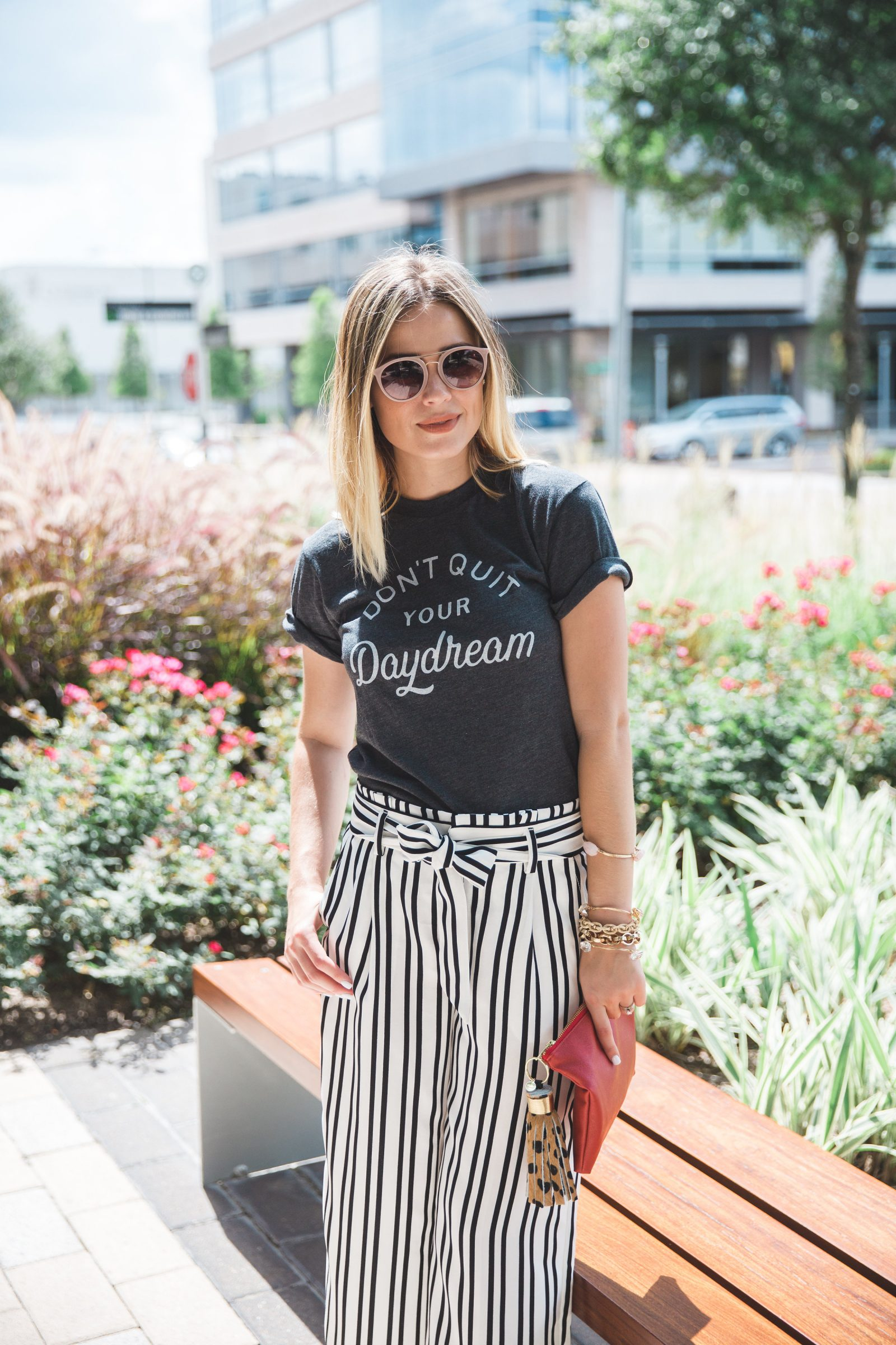 Houston fashion blogger Elly Brown wears the HOME tee with paper bag pants