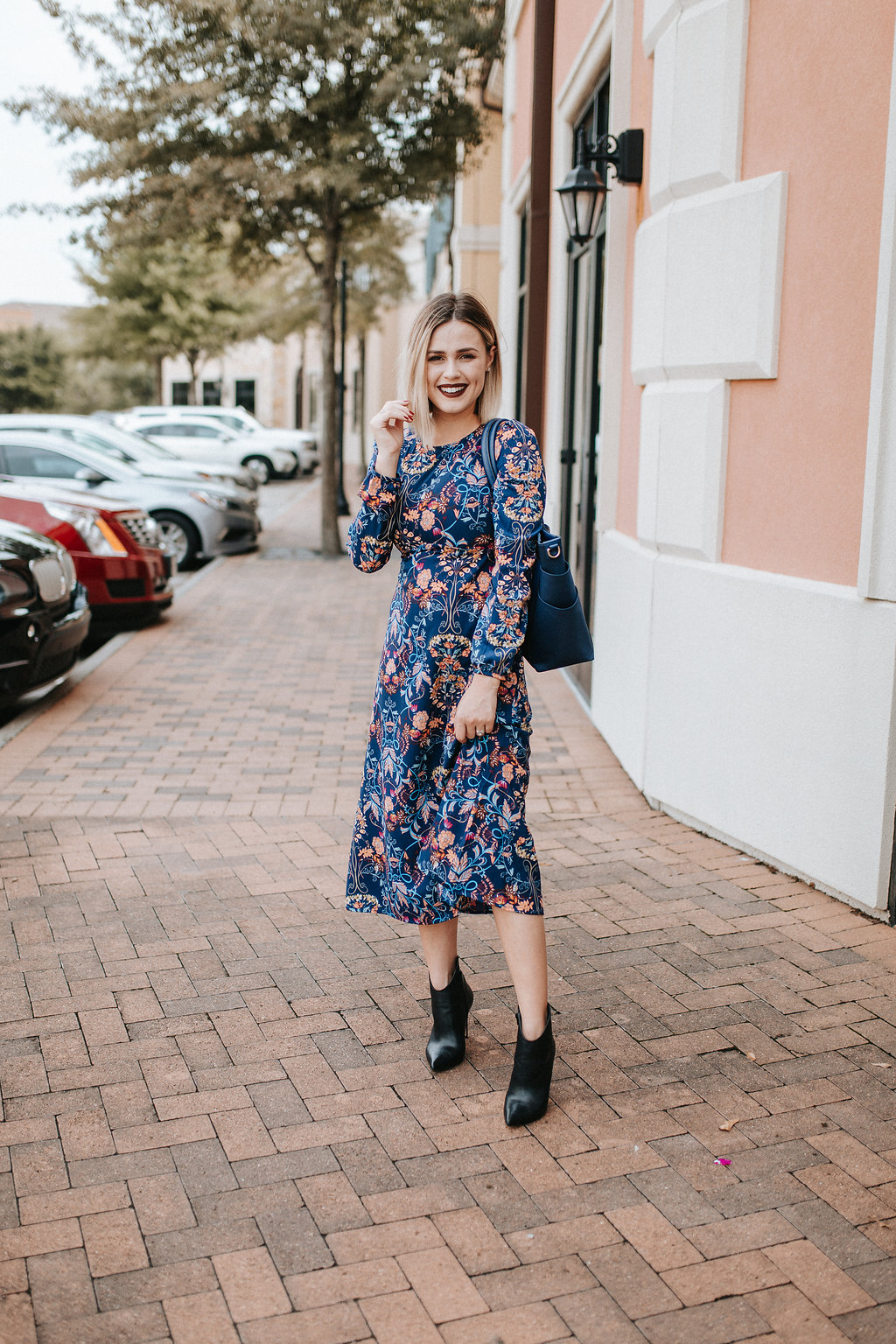 Housont fashion blogger Uptown with Elly Brown wears a blue floral dress from Lulu's for under $75!