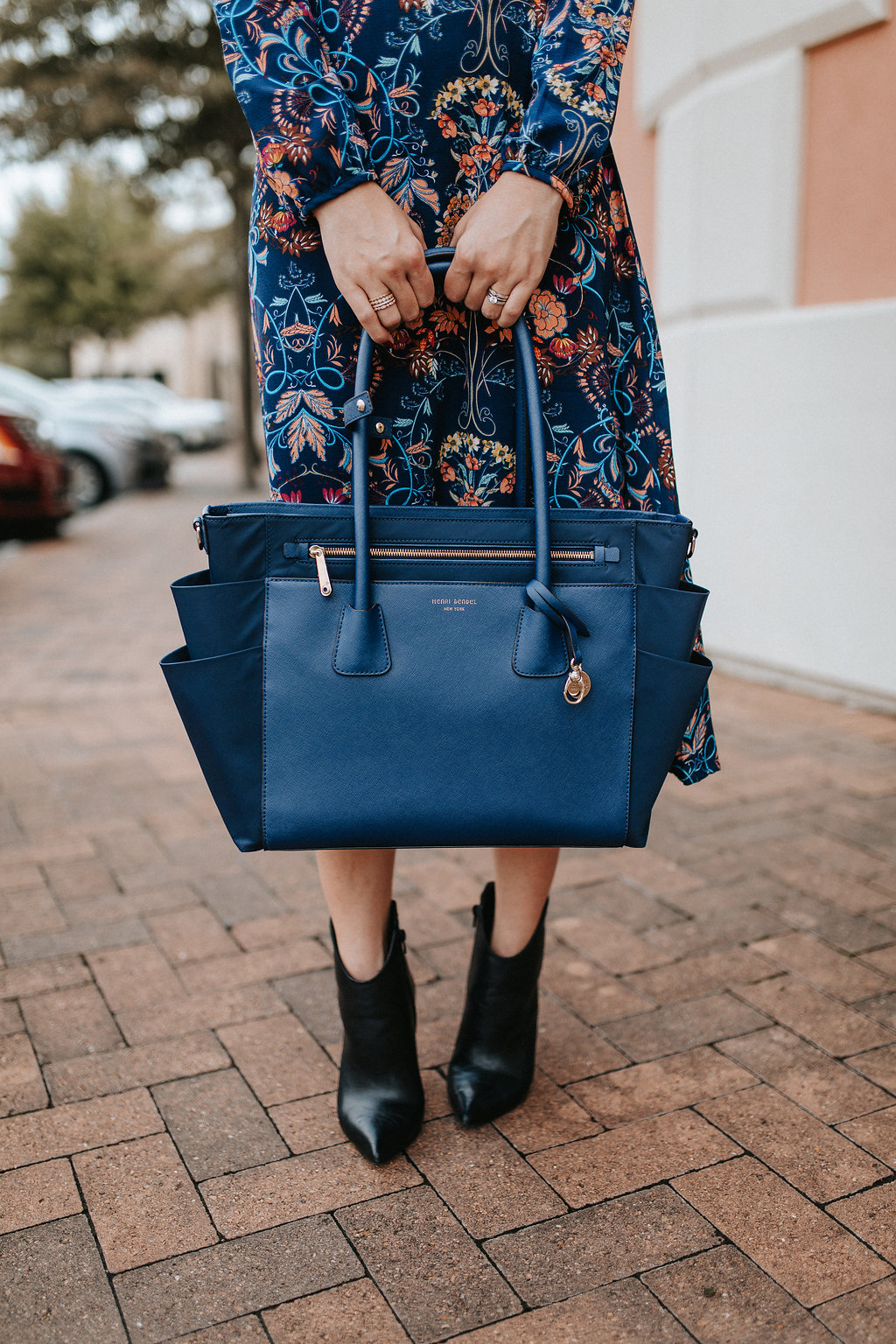 Housont fashion blogger Uptown with Elly Brown wears a blue diaper bag from Henri Bendel!