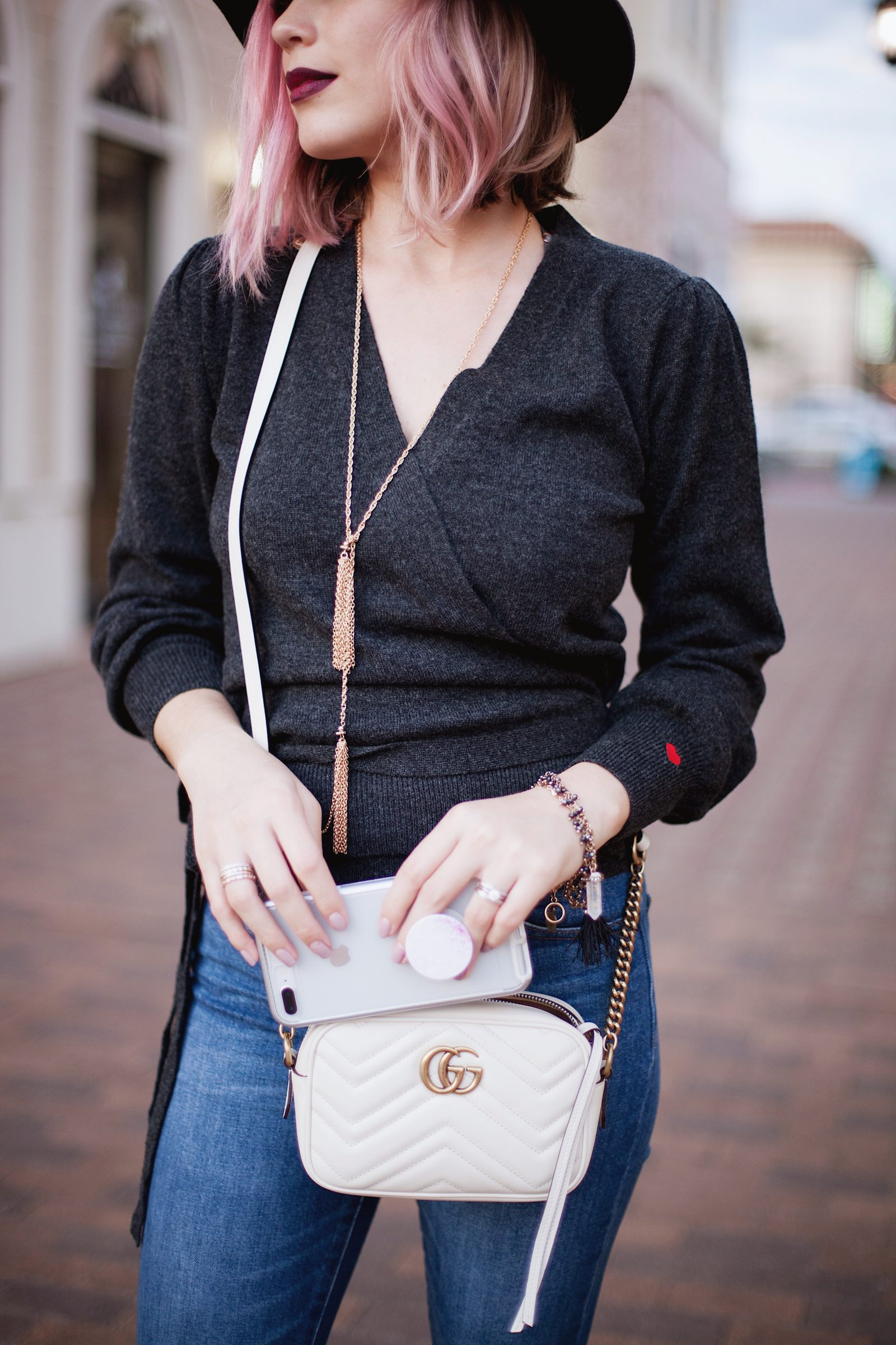 Houston Fashion blogger Uptown with Elly Brown shares how to style a Wrap Sweater for fall