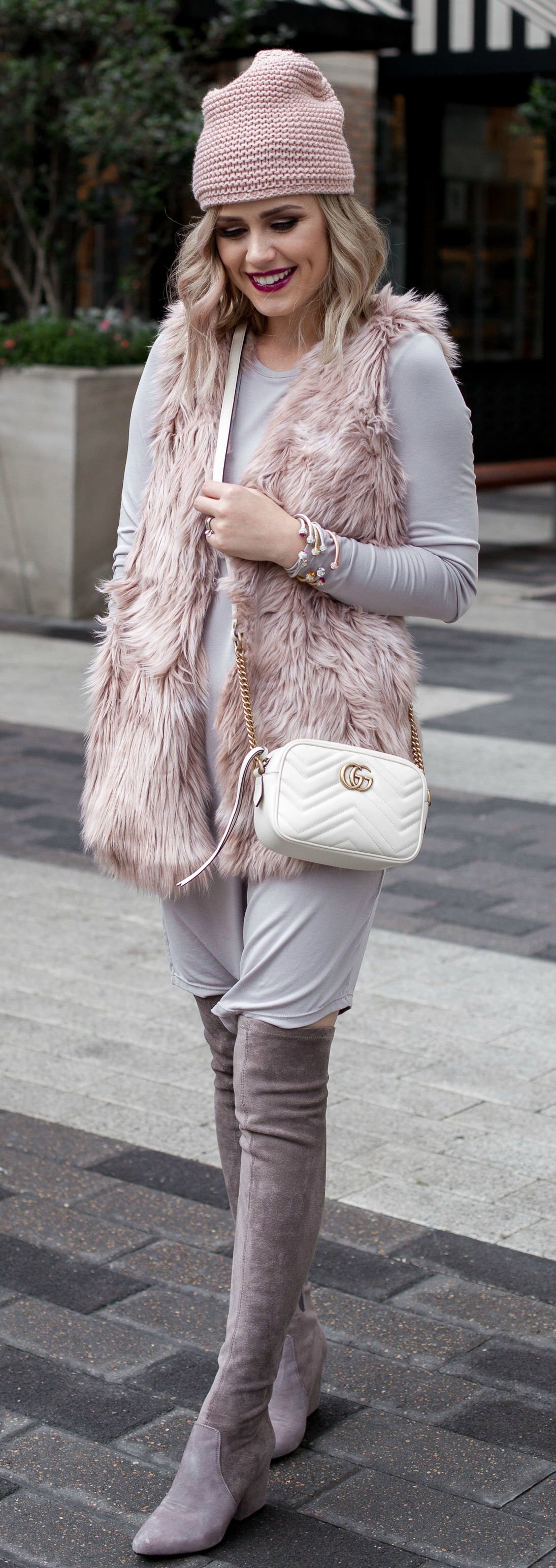 Faux fur vest outfit | winter outfit | chic outfit | OTK boots with dress | Uptown with Elly Brown