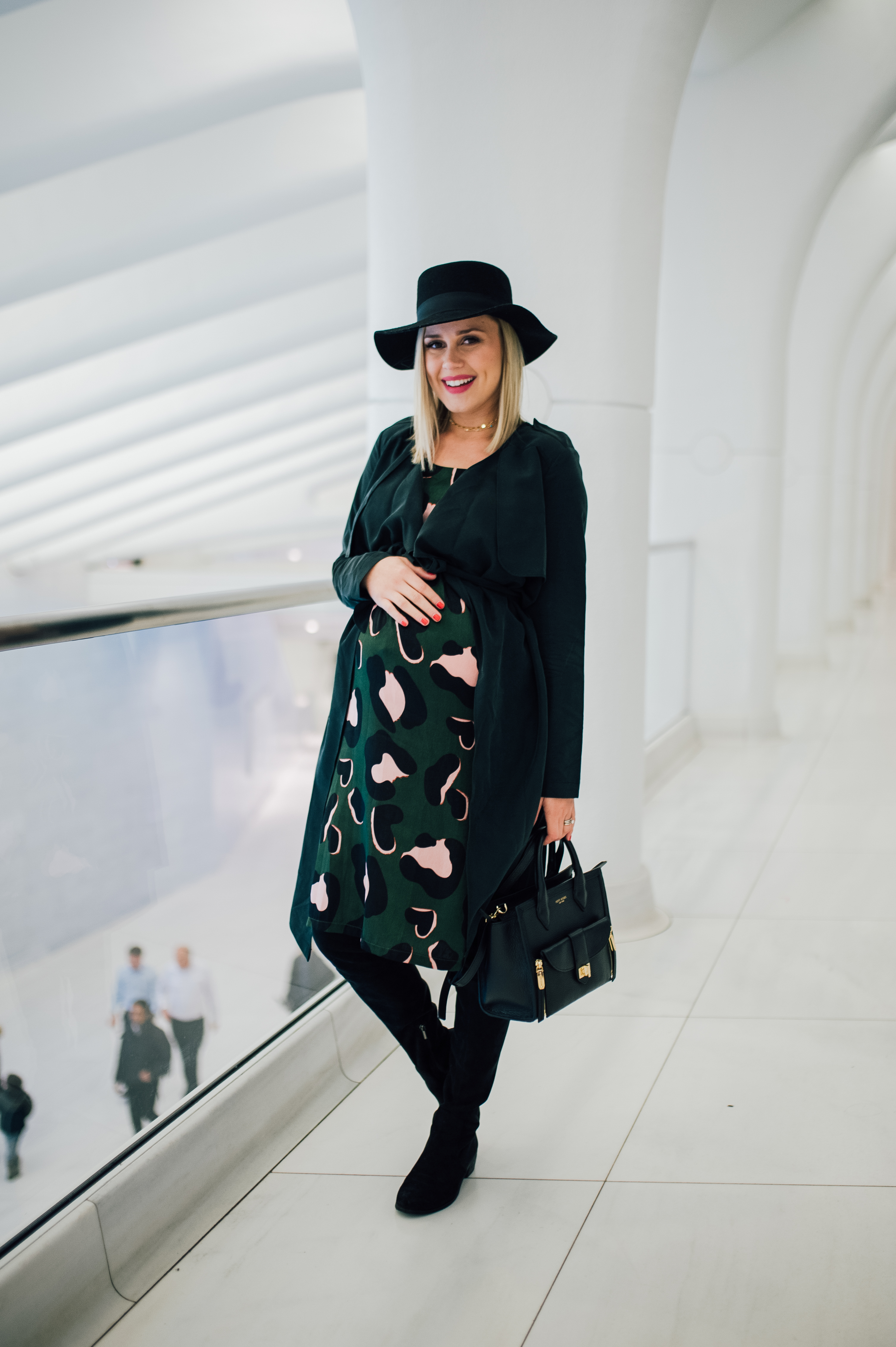 Houston fashion blogger Uptown with Elly Brow shares over 15 winter outfits and how to wear Over The Knee Boots. Click here for more!