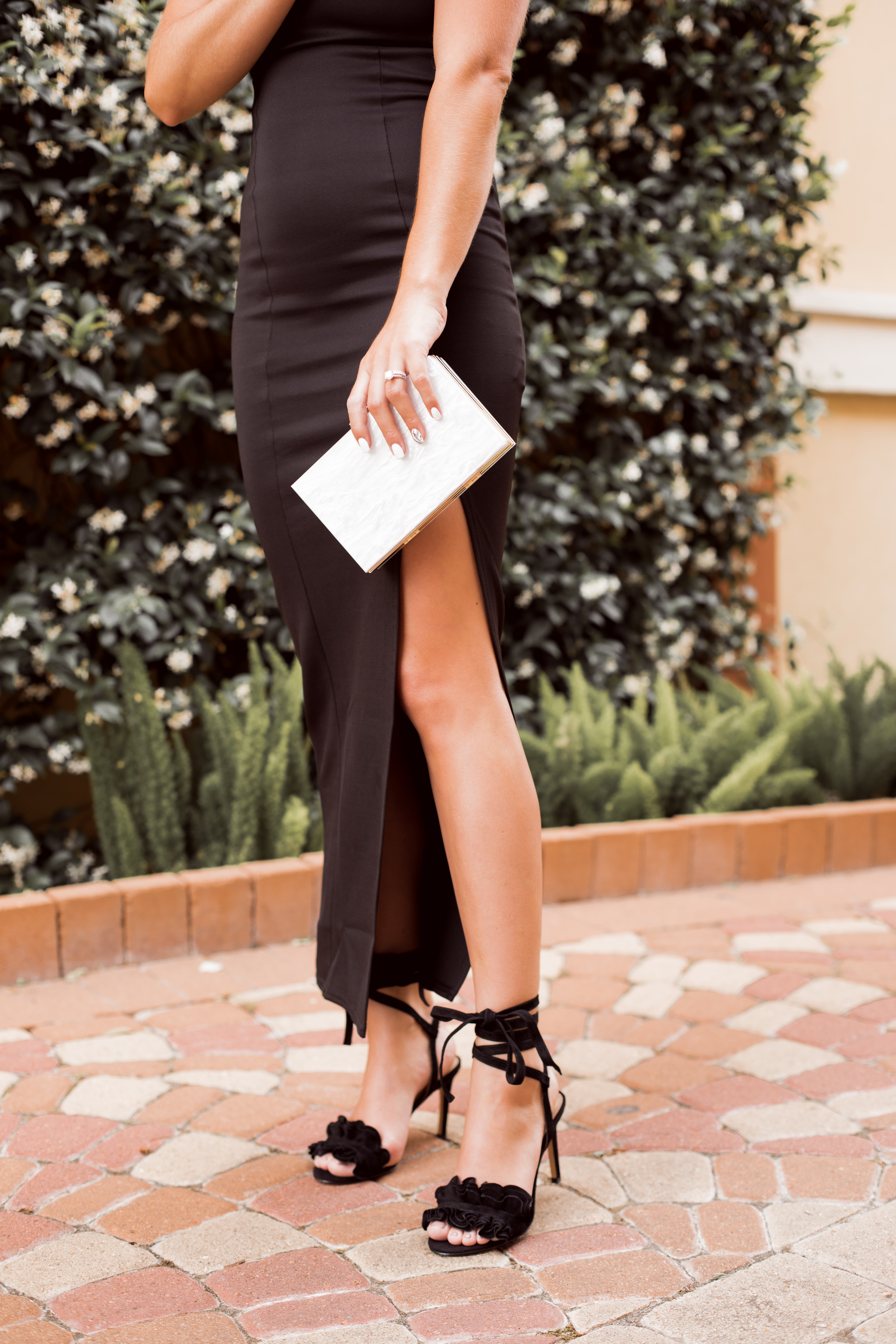 Houston fashion blogger Uptown with Elly Brown shares What To Wear To A Formal Wedding and her top formal dress picks under $100. Click here for more!