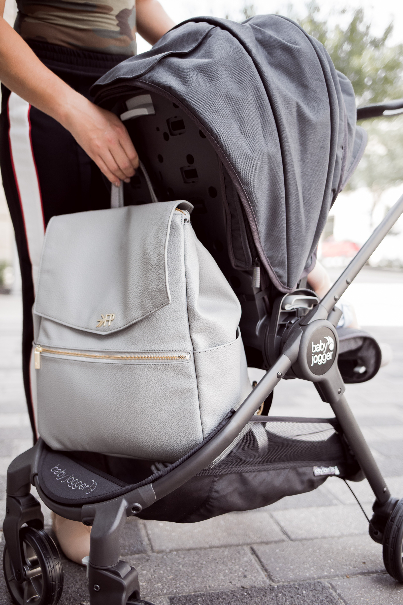 Houston lifestyle blogger Uptown with Elly Brown shares her review on the Baby Jogger City Tour LUX stroller and why it's great for families on the go!
