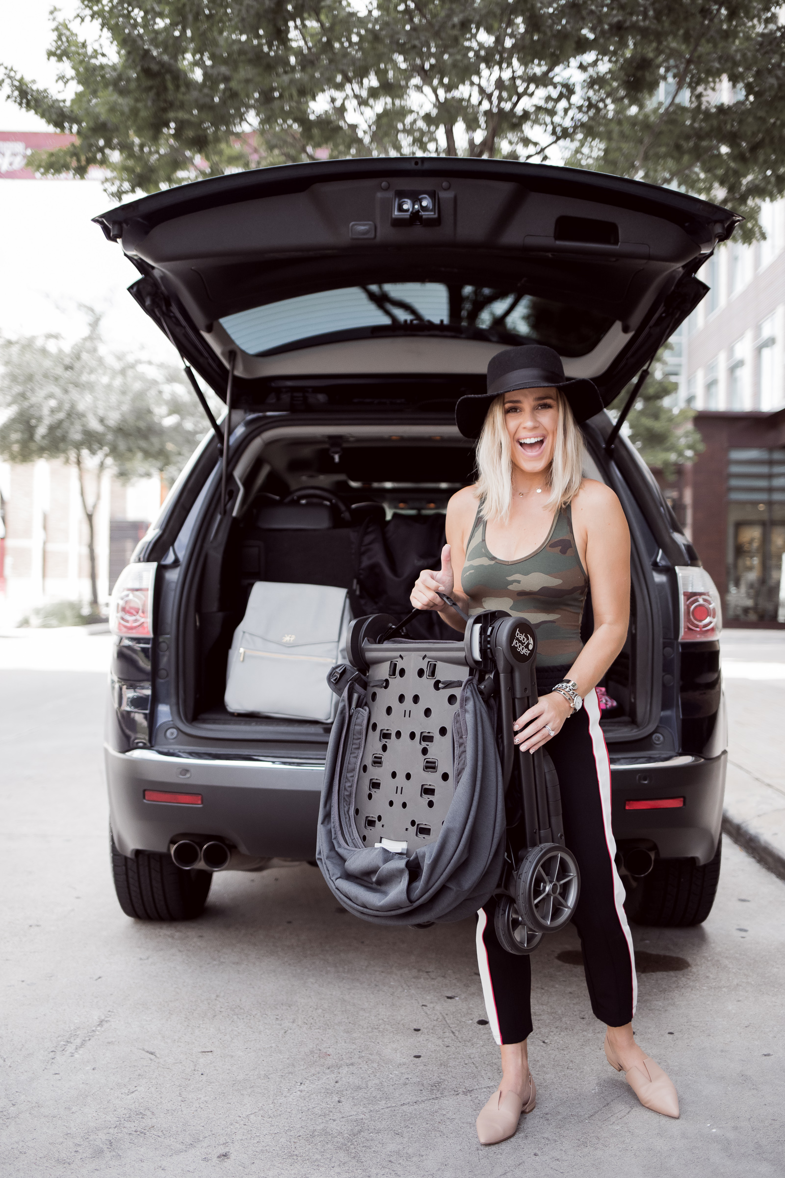 Houston lifestyle blogger Uptown with Elly Brown shares her review on the Baby Jogger® City Tour™ LUX stroller and why it's great for families on the go!