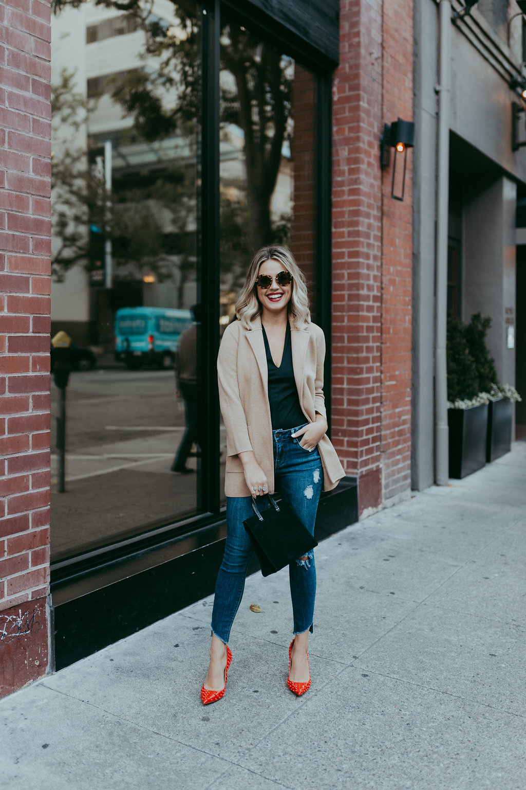 Houston fashion blogger Uptown with Elly Brown shares why every woman needs at least one Blazer Jacket in her closet and why. Click here for more!