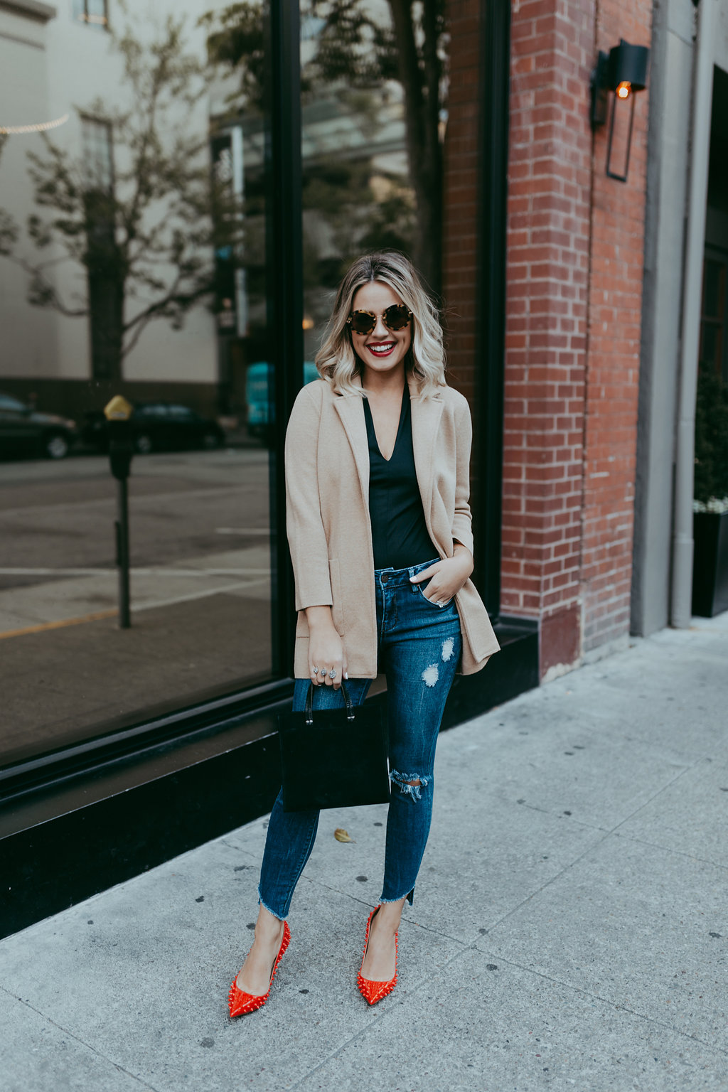 Looking for ideas on How To Wear A Blazer? Houston fashion blogger Uptown with Elly Brown wears her blazer with distressed denim