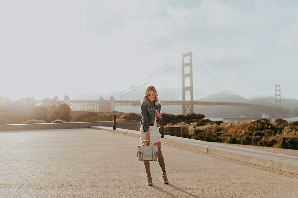 Houston fashion blogger Elly Brown wears over the knee boots and a tweed dress