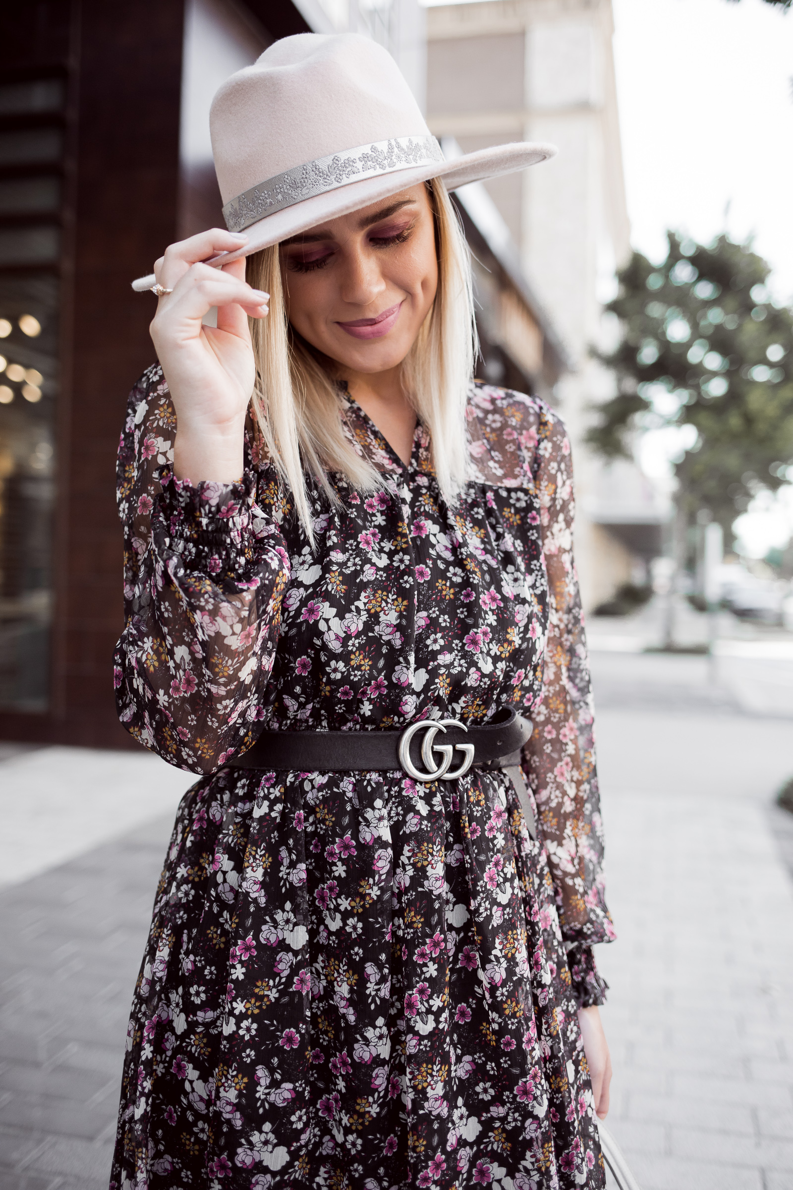 Houston fashion blogger Uptown with Elly Brown wears a wool pandora from Henri Bendel