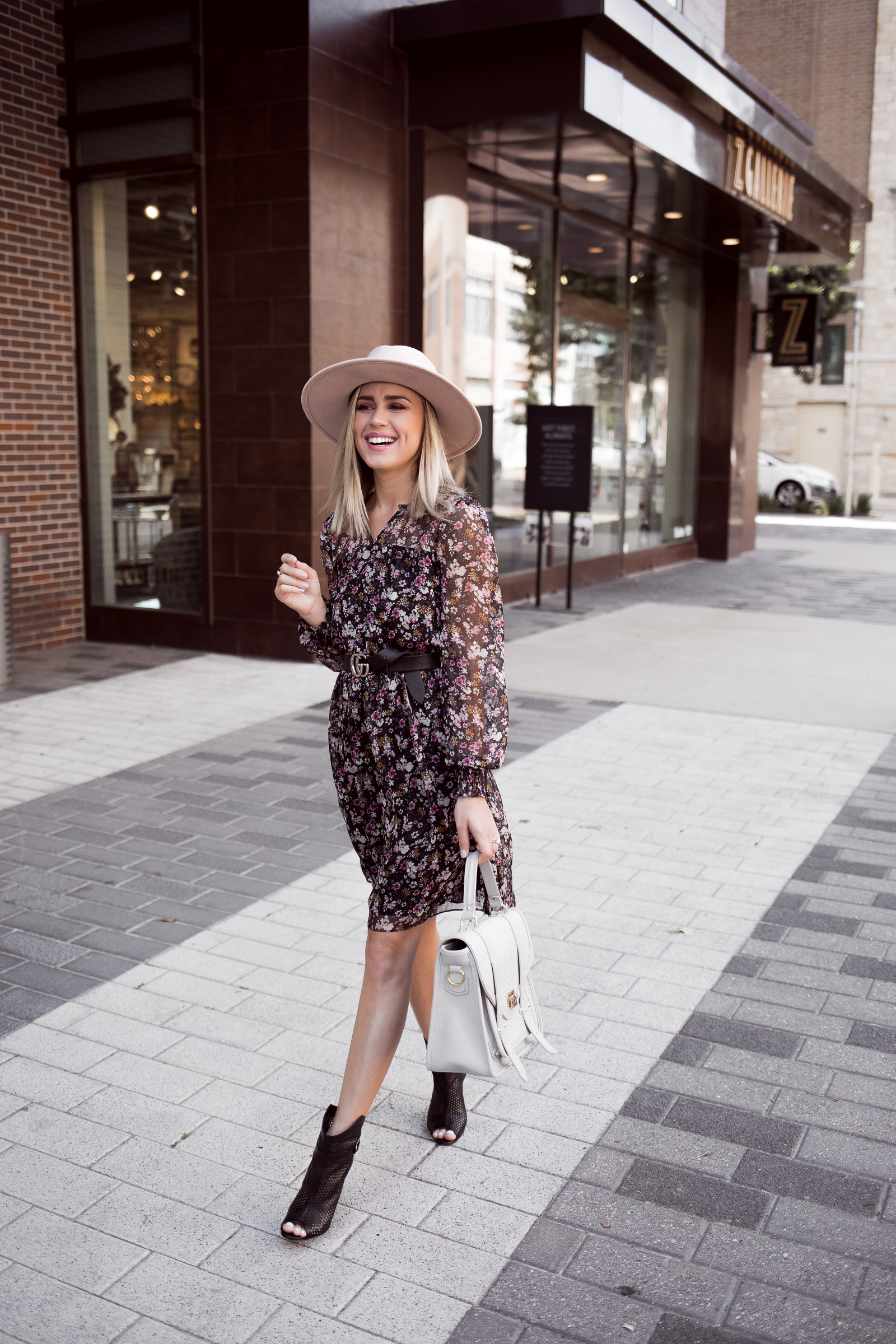 Houston fashion blogger Uptown with Elly Brown wears a smock floral dress for fall!