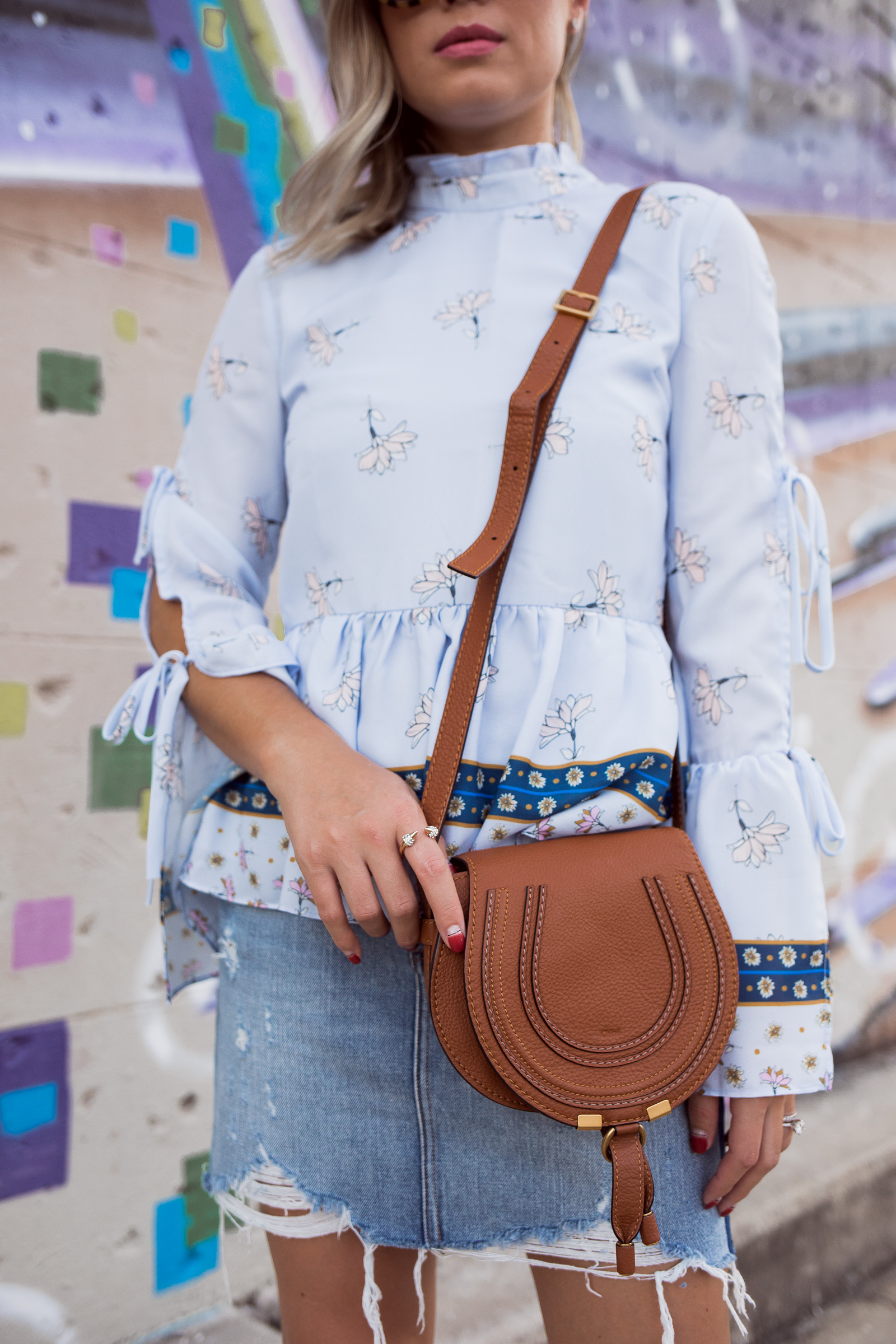Houston fashion blogger Uptown with Elly Brown wears a denim skirt for Fall