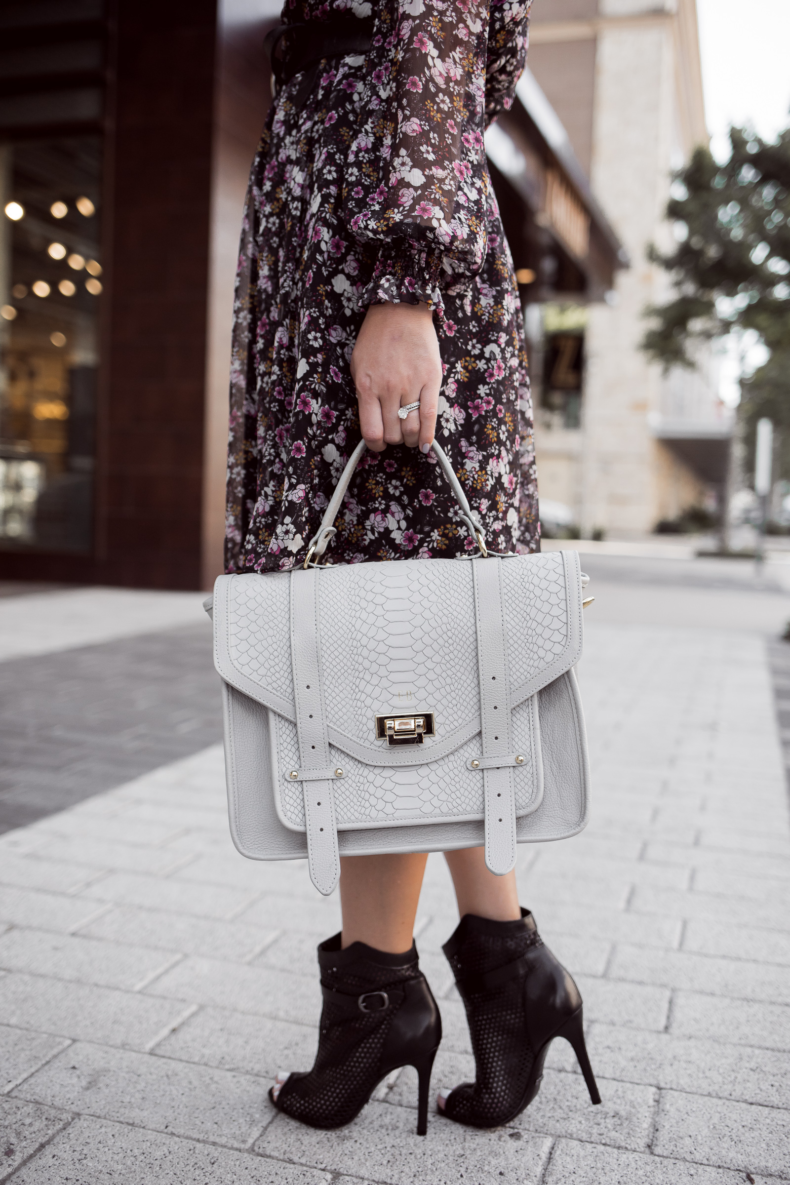 Houston fashion blogger Uptown with Elly Brown wears a Grey Gigi New York Saddle Bag and Schutz boots
