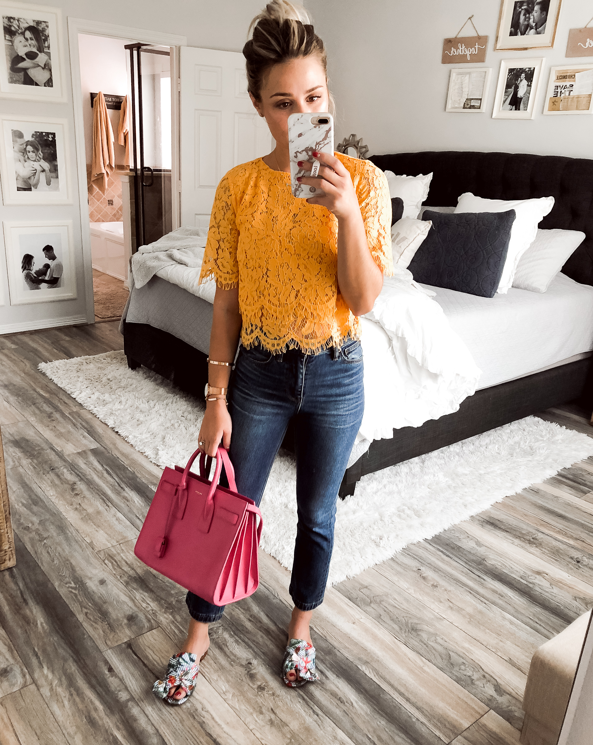 Houston fashion blogger Uptown with Elly Brown wears a yellow lace top