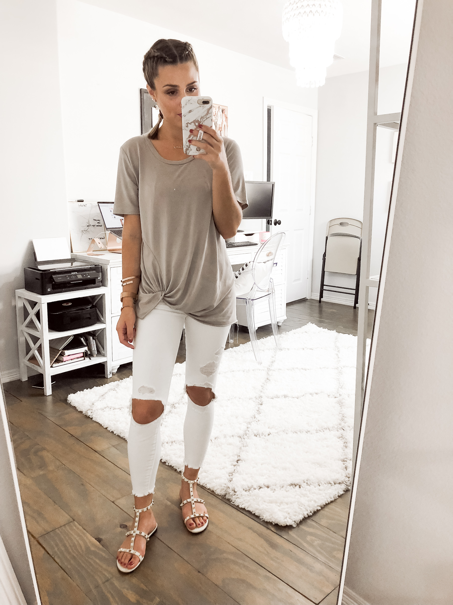 Houston fashion blogger Uptown with Elly Brown wears white distressed denim