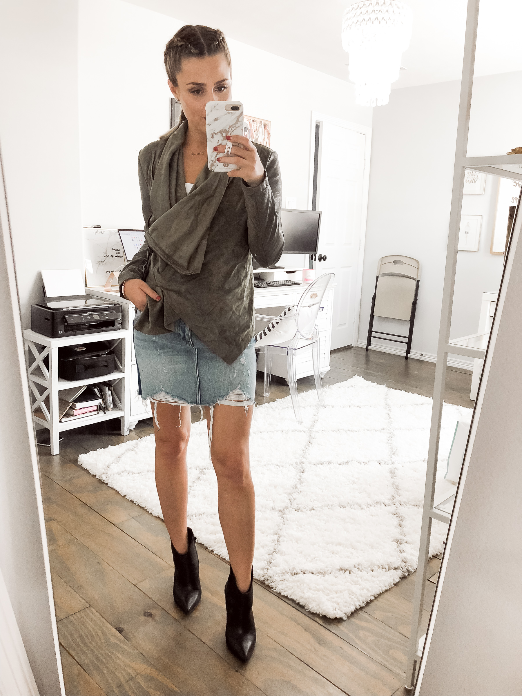Houston fashion blogger Uptown with Elly Brown wears a denim skirt for a fall outfit
