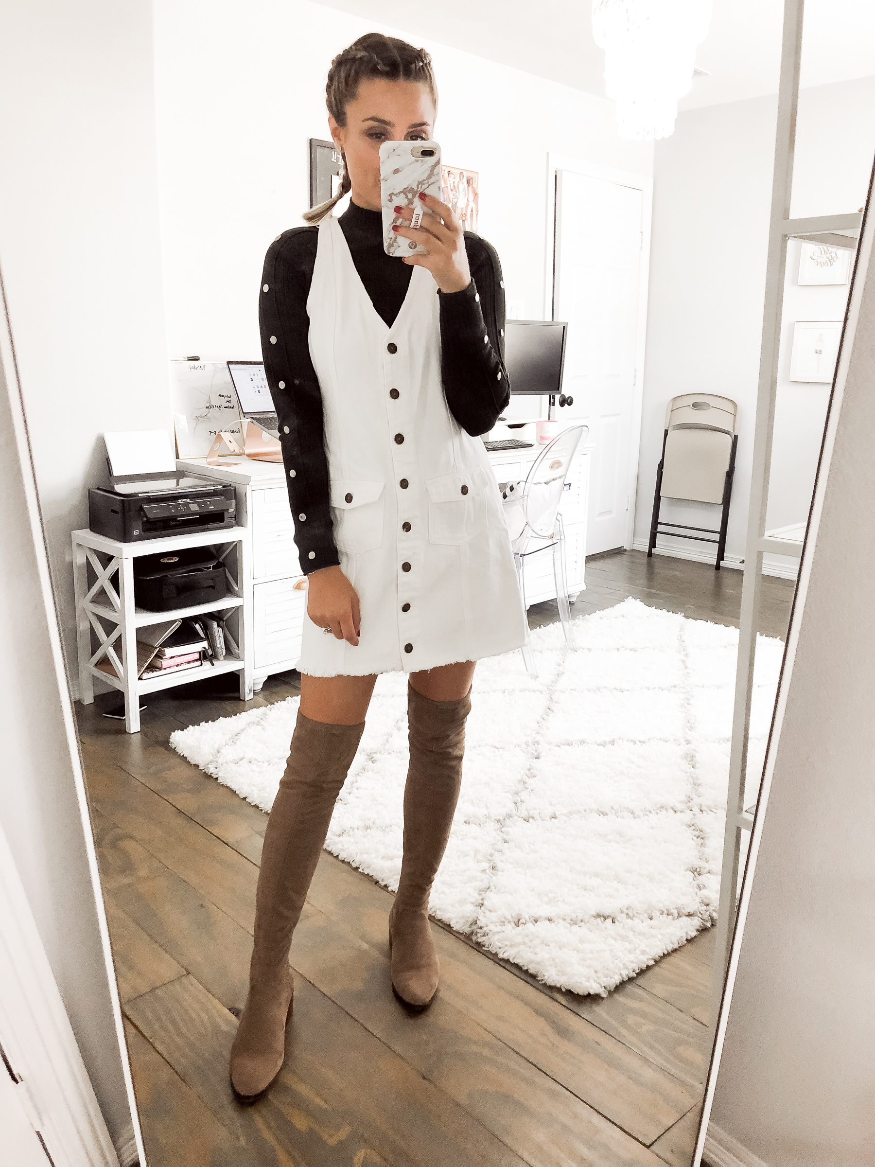 Houston fashion blogger Uptown with Elly Brown wears a white denim button up dress