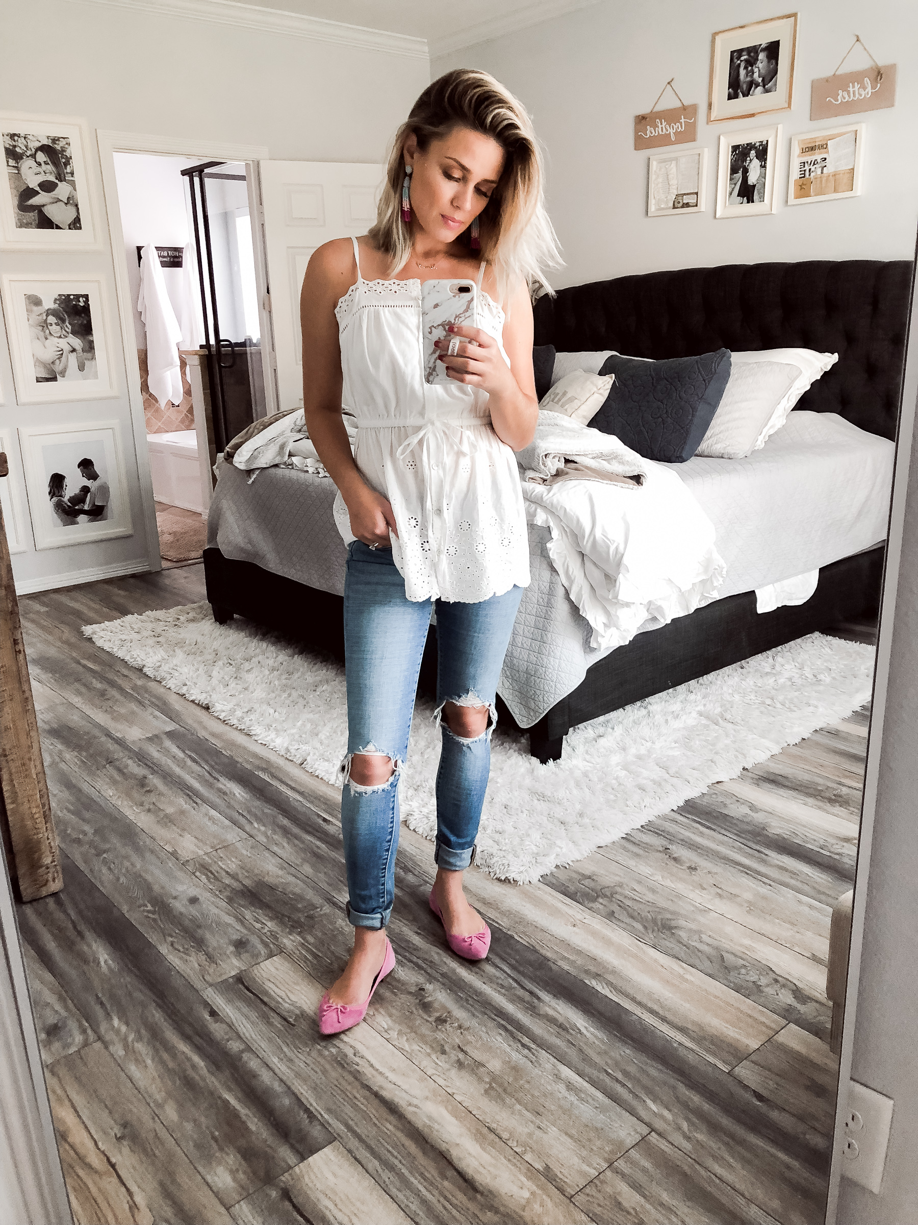 Houston fashion blogger Uptown with Elly Brown wears pink flats paired with distressed denim