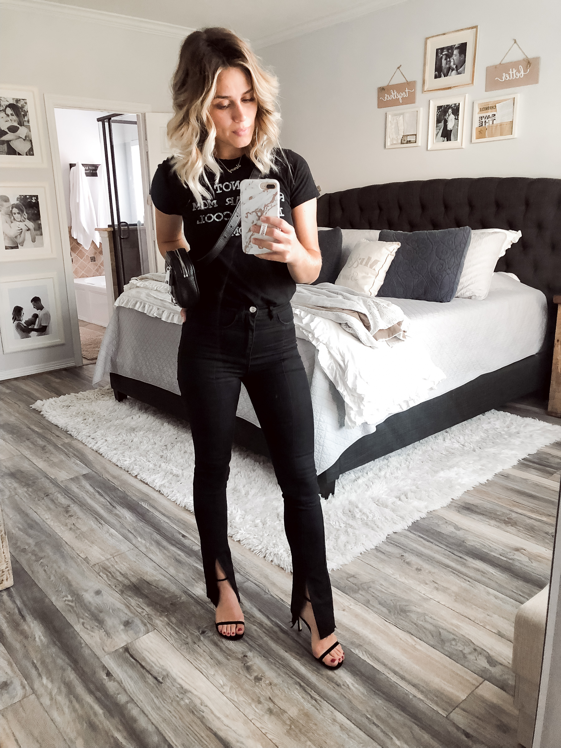 Houston fashion blogger Uptown with Elly Brown wears an all black 90's inspired outfit