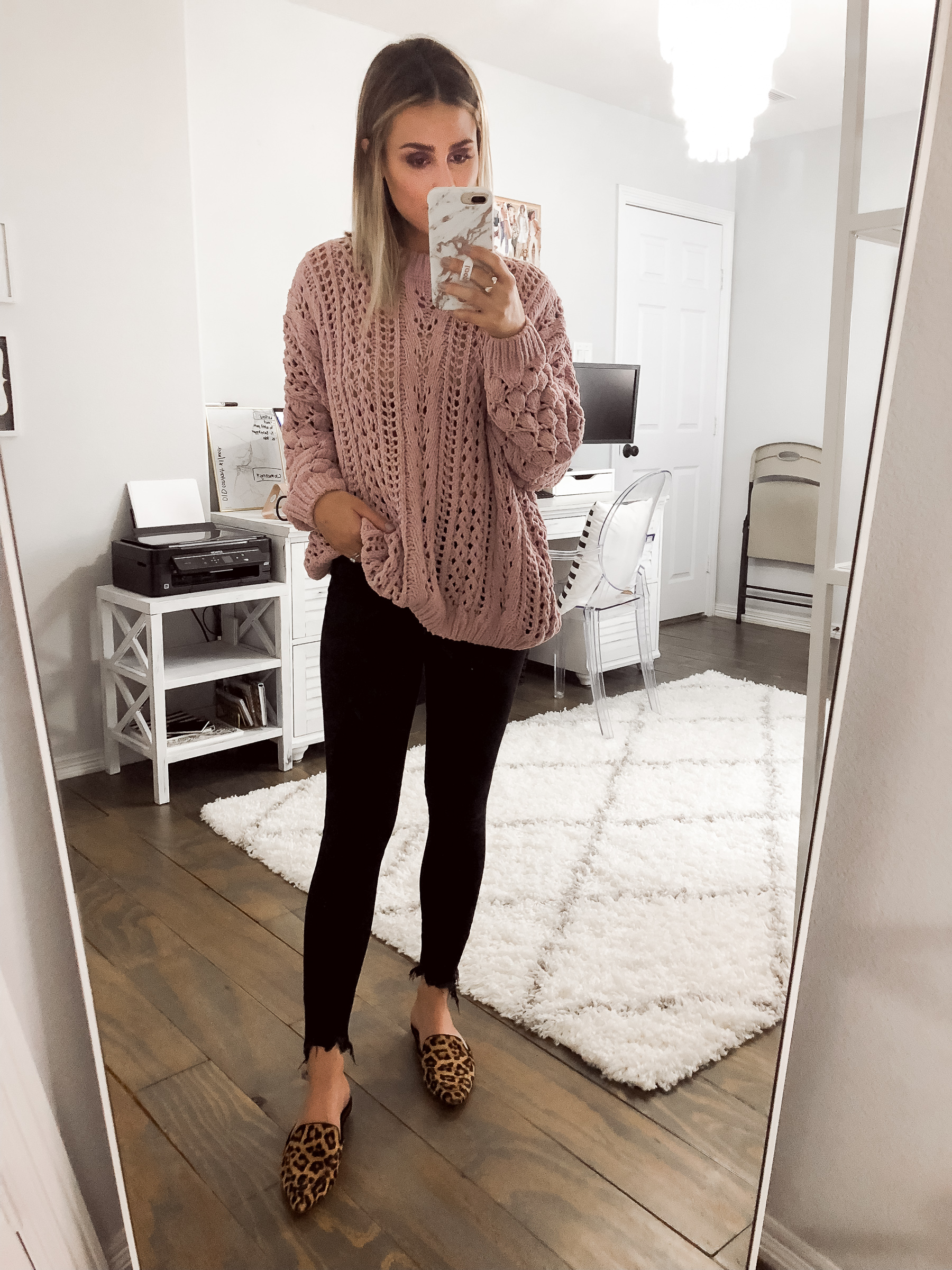 Houston fashion blogger Uptown with Elly Brown wears a chunky sweater with leopard mules