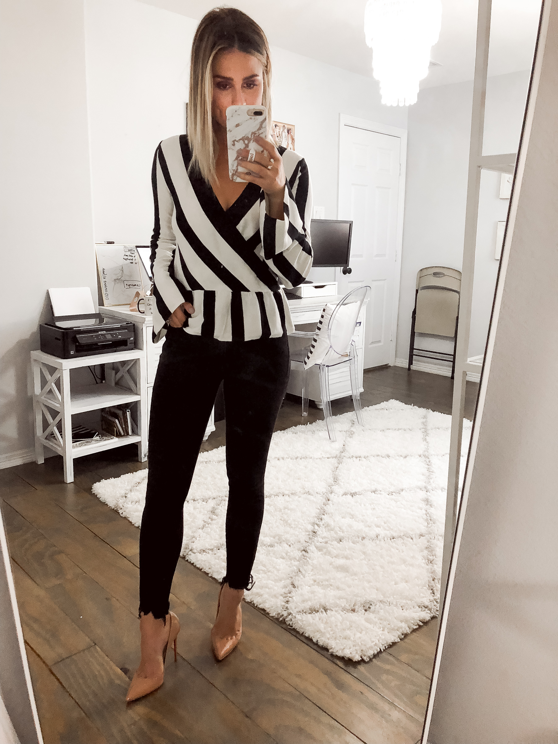 Houston fashion blogger Uptown with Elly Brown wears a black and white sweater for fall