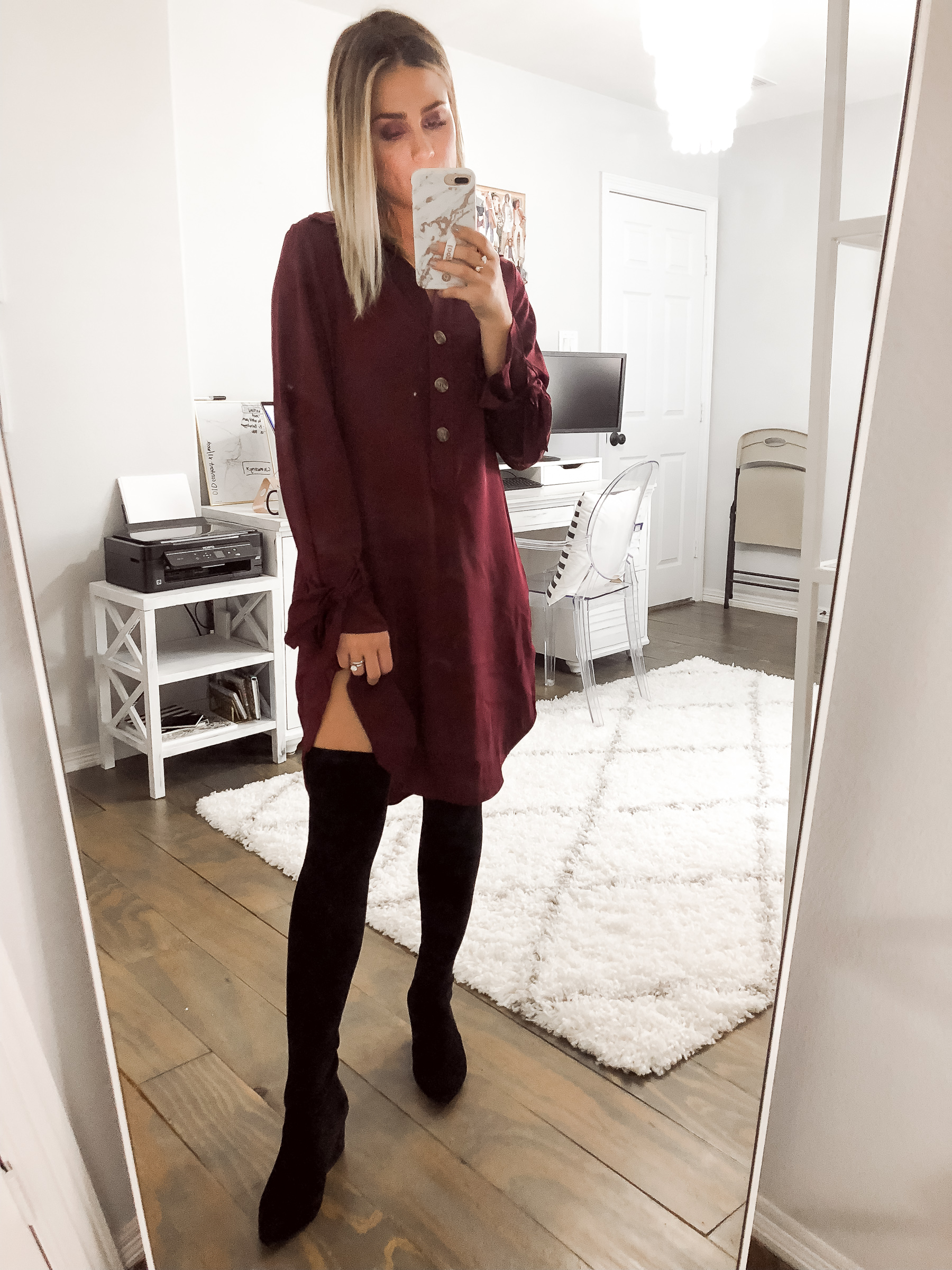 Houston fashion blogger Uptown with Elly Brown wears an oversized t-shirt dress with over the knee boots