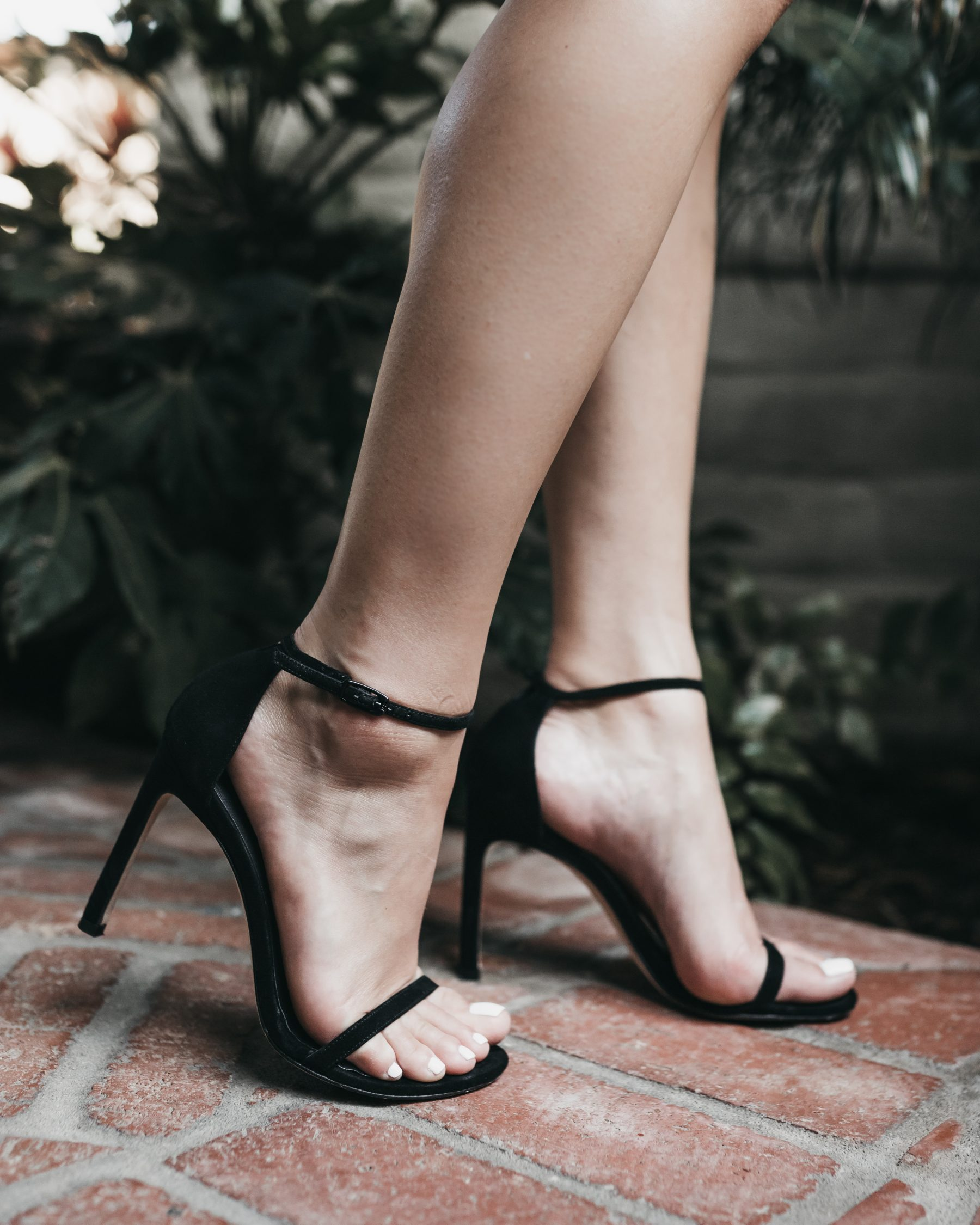 Houston fashion blogger Uptown with Elly Brown wears a black Stuart Weitzman Nudistsong Ankle Strap Sandal