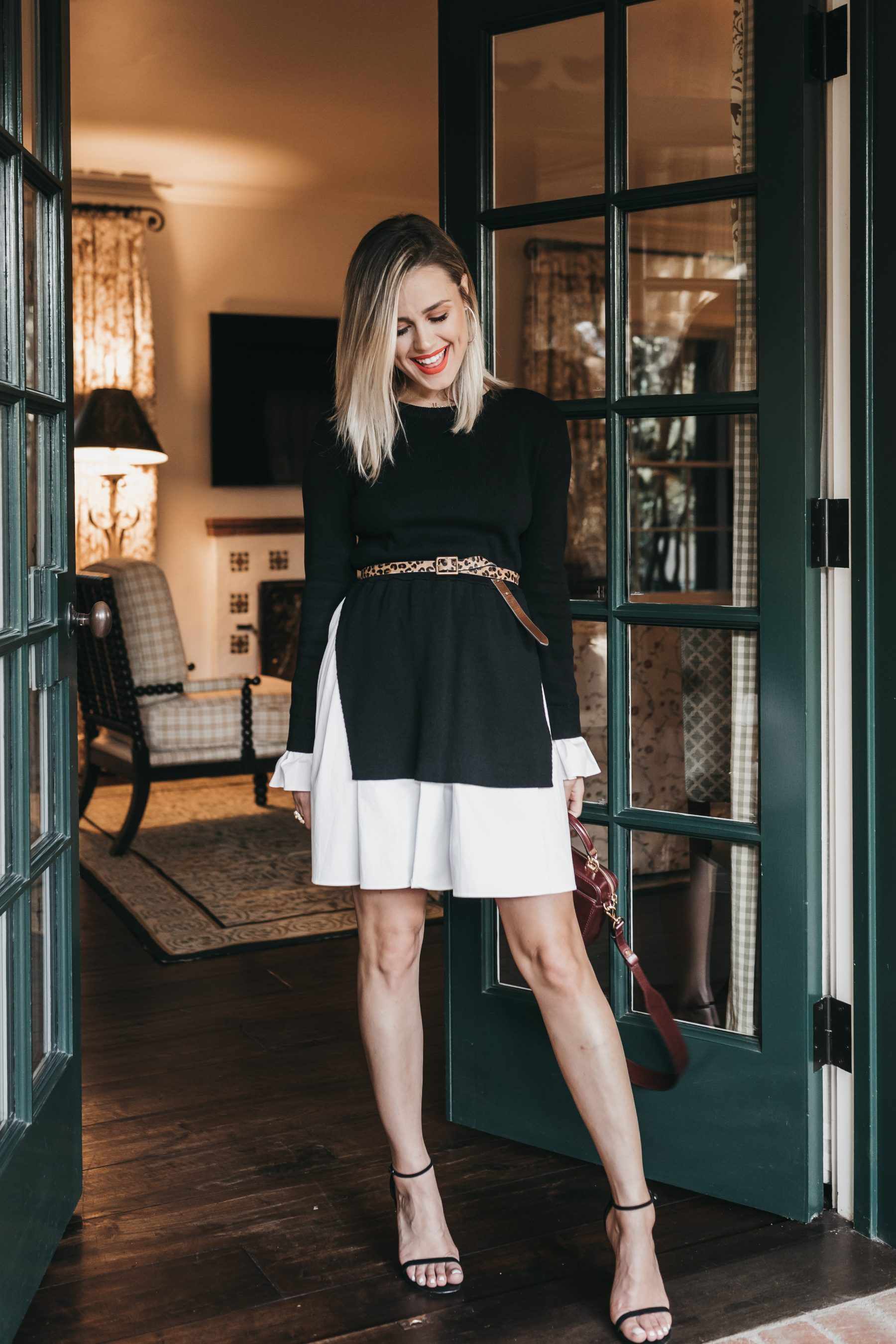 Houston fashion blogger Uptown with Elly Brown wears a Knit Combo Dress paired with an oxford bag for the fall season.