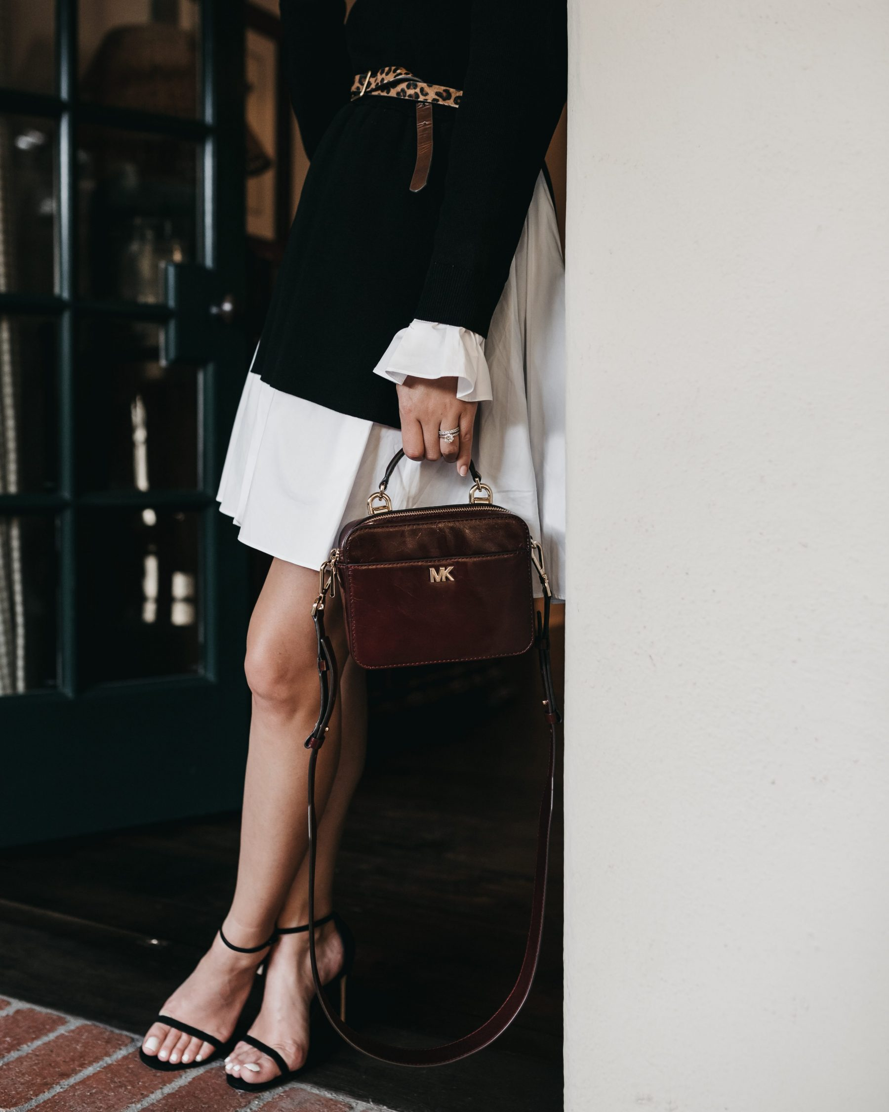 Houston fashion blogger Uptown with Elly Brown wears a MICHAEL KORS Mott Mini oxford leather Crossbody