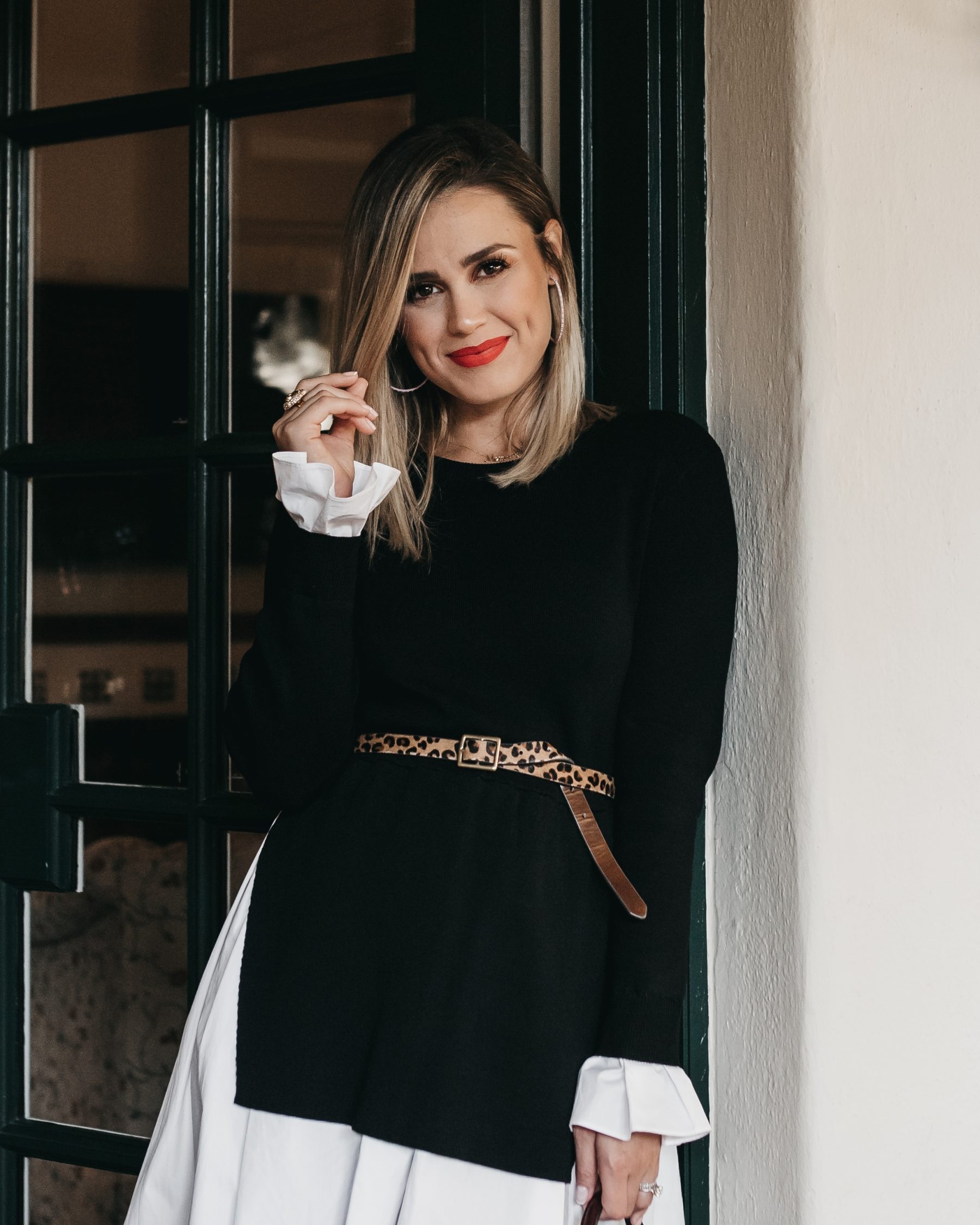 Houston fashion blogger Uptown with Elly Brown wears a leopard target belt with a dress