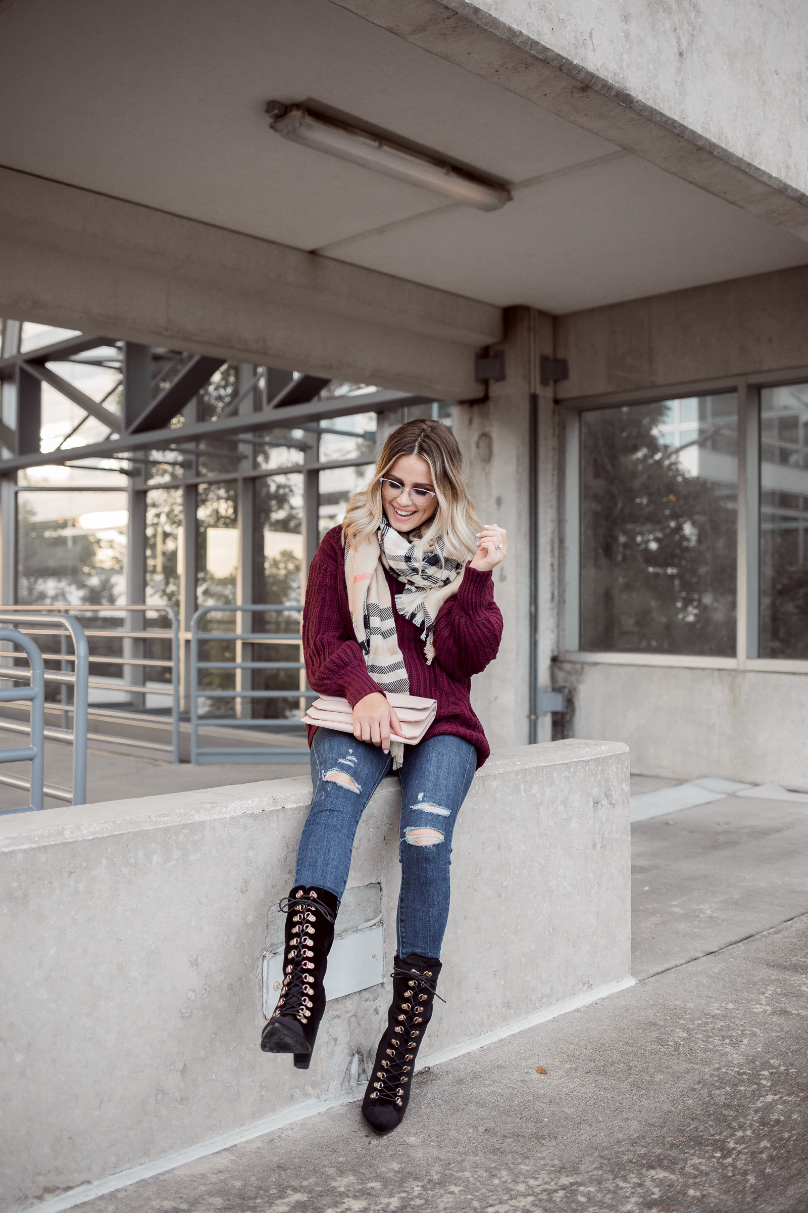 Houston Fashion blogger Uptown with Elly Brown wears a chunky cable knit sweater