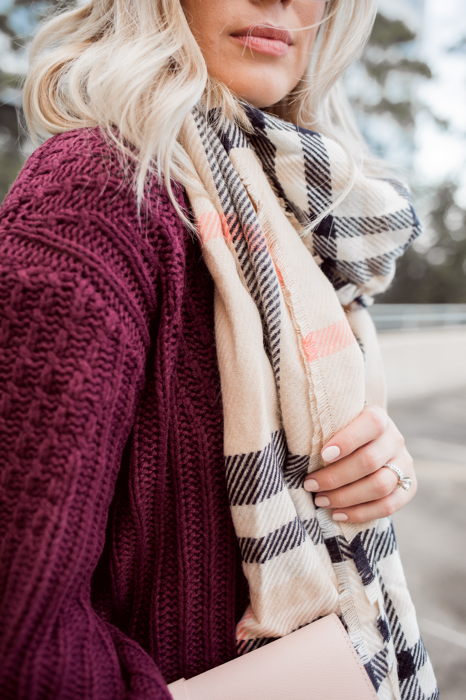 Houston fashion blogger Uptown with Elly brown wears a plaid blanket scarf for fall