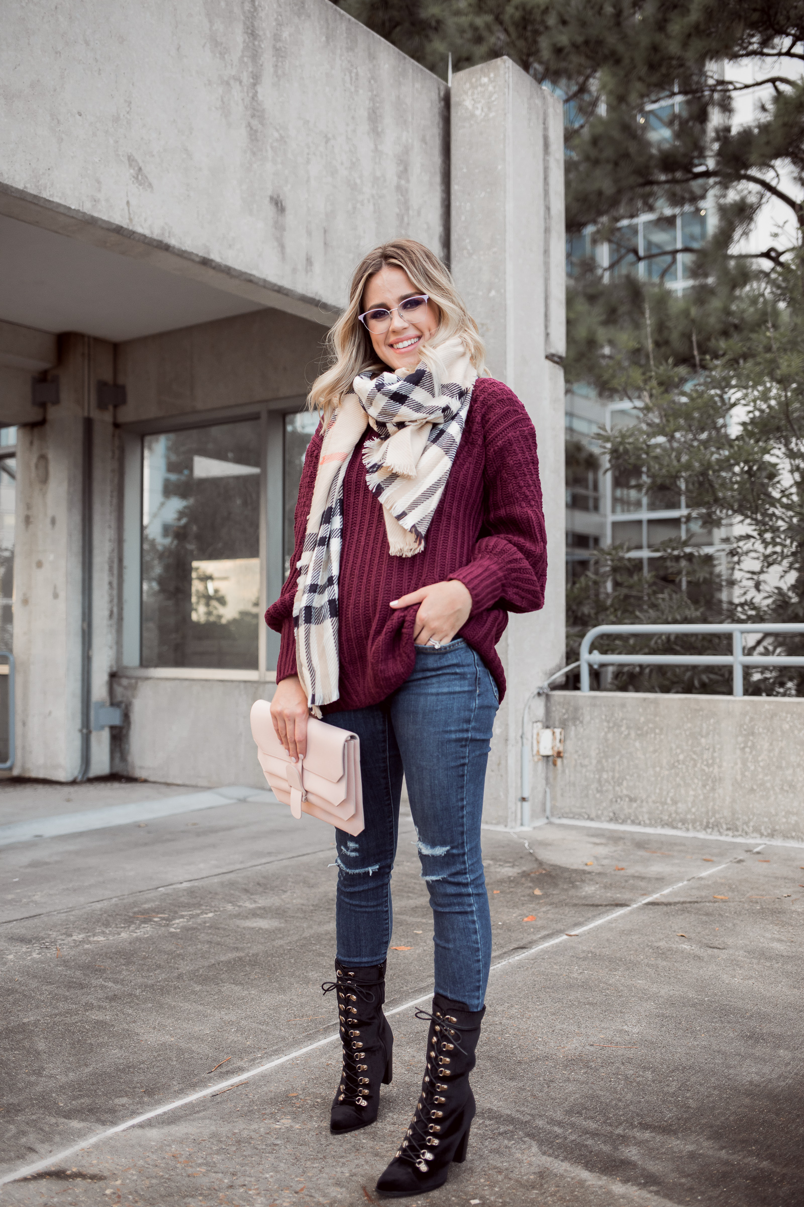 Houston Fashion blogger Uptown with Elly Brown wears Levi denim and a chunky sweater for fall