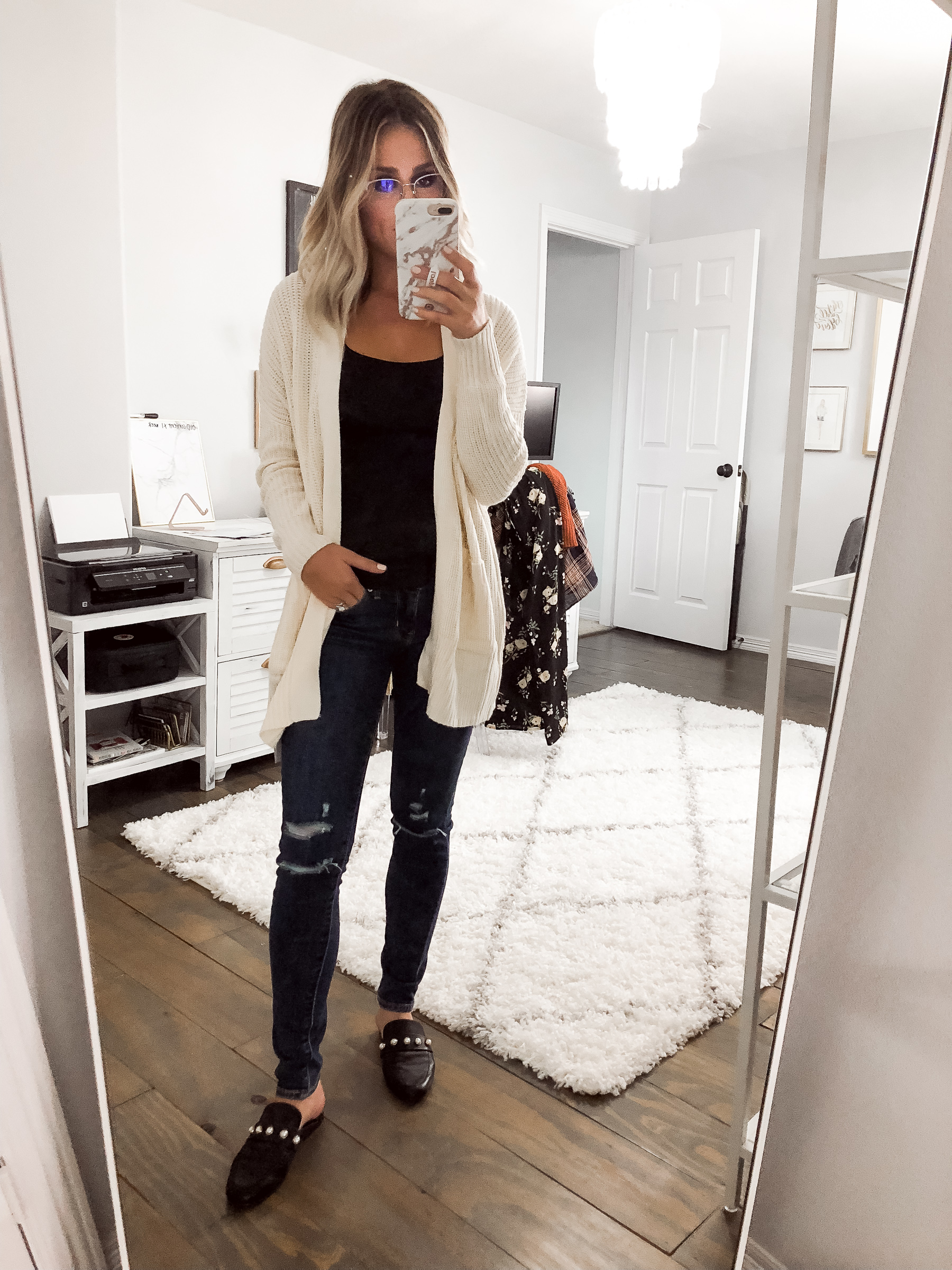 Houston Fashion blogger Uptown with Elly Brown wears a cozy cardigan and black mules
