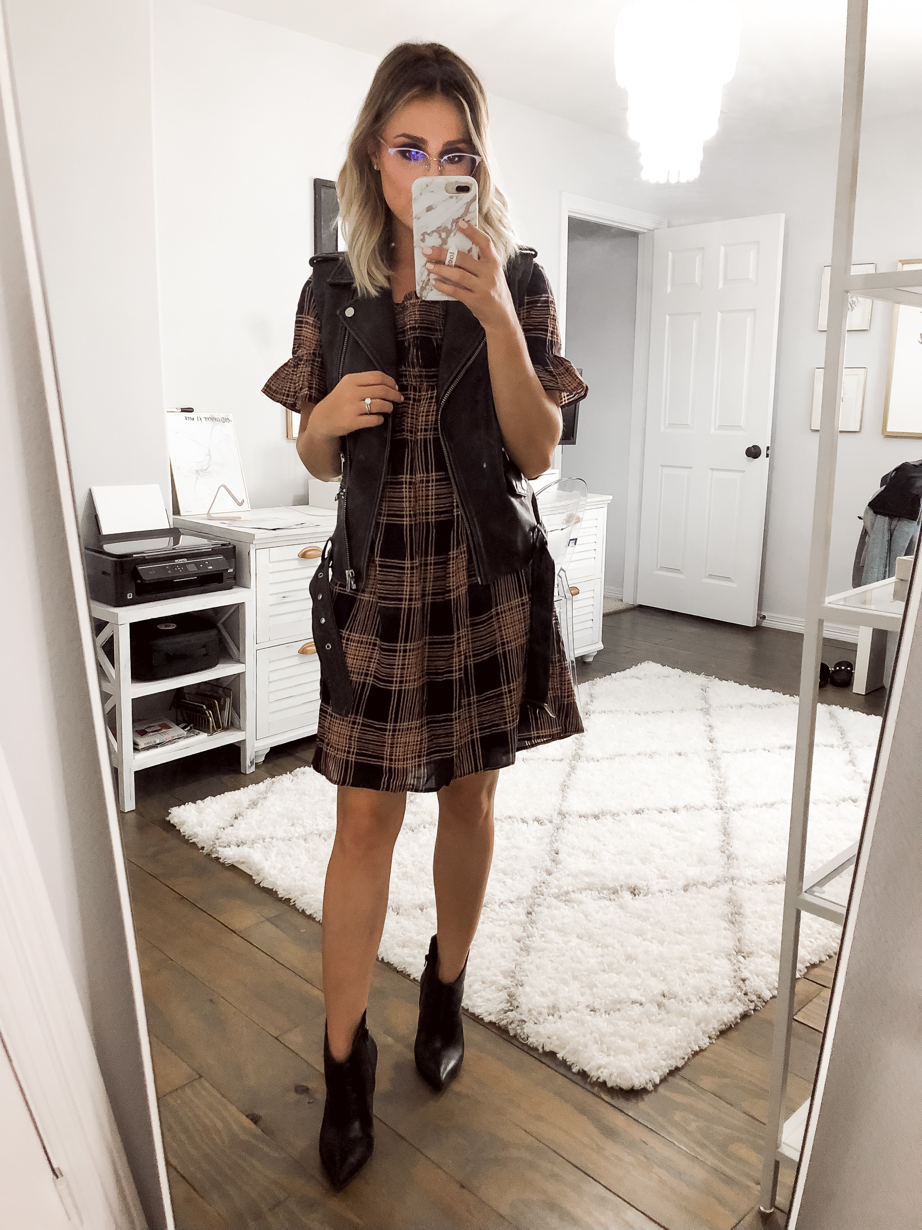 Houston Fashion blogger Uptown with Elly Brown wears a plaid dress with ankle boots