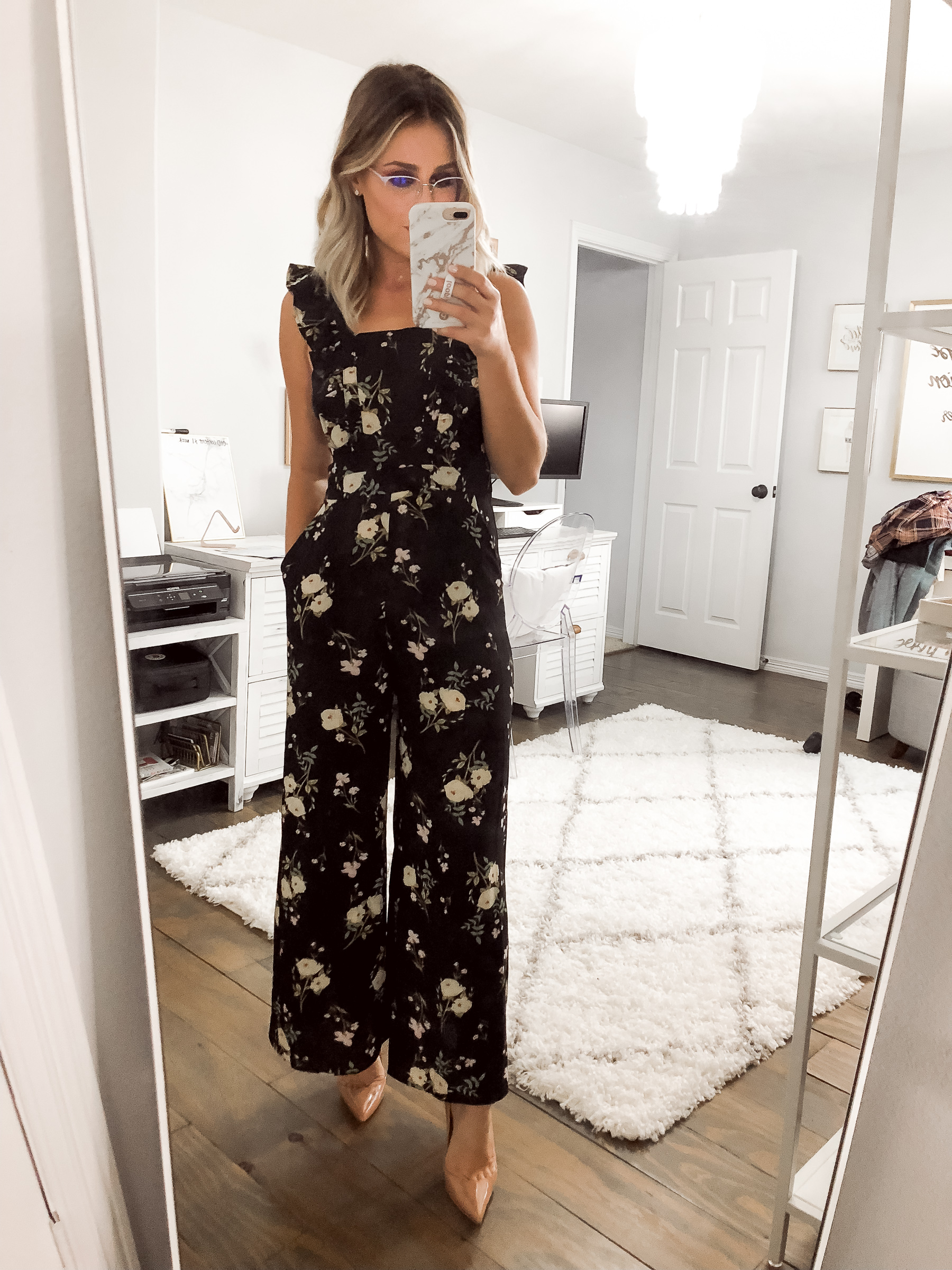 Houston Fashion blogger Uptown with Elly Brown wears a floral jumpsuit