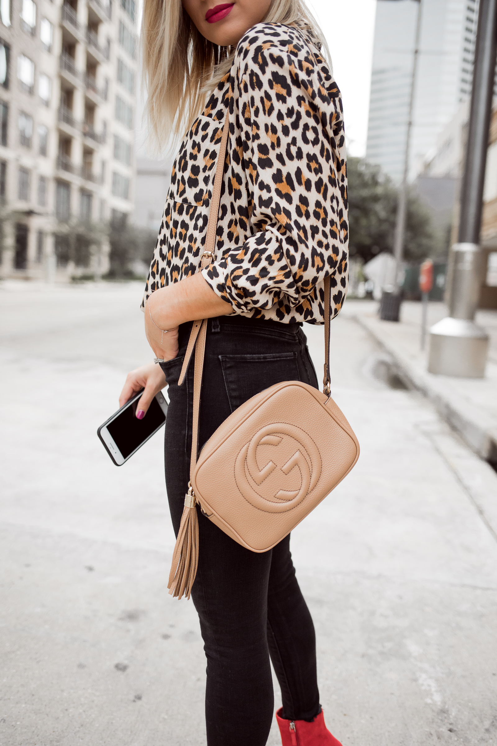 Houston fashion blogger Uptown with Elly Brown wears a Gucci nude crossbody bag